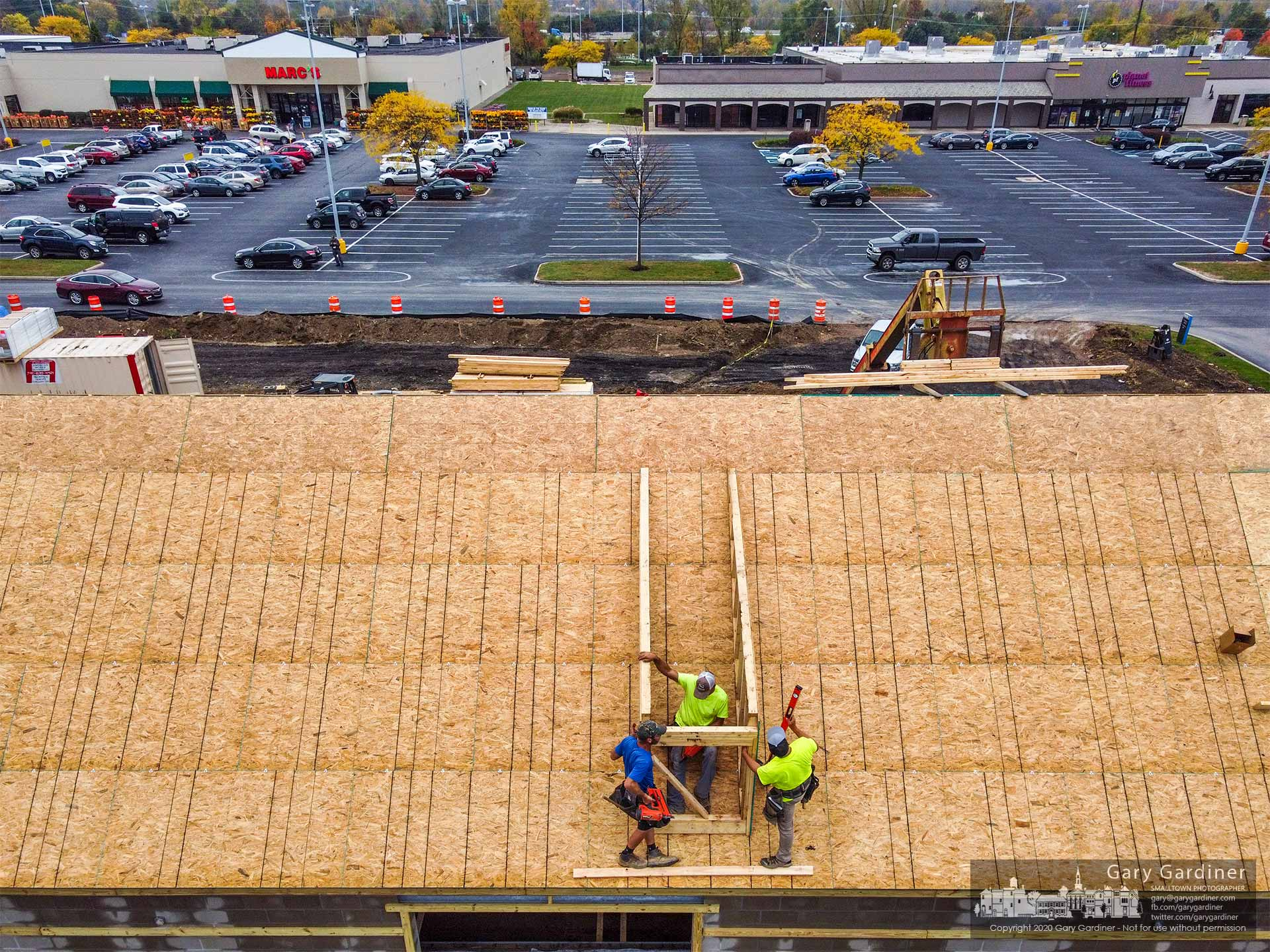Carpenters build the frame for a dormer on the roof of the Moo Moo Car Wash under construction on Huber Village Boulevard in Westerville. My Final Photo for Oct. 21, 2020.