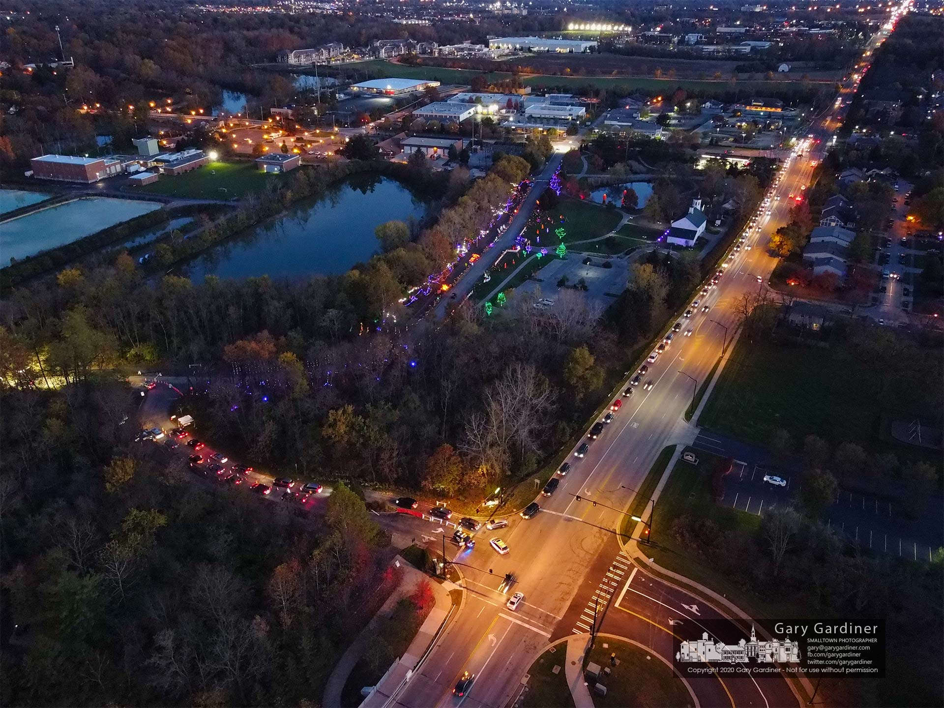 Cars line up at the entrance to Heritage Park on Cleveland Avenue for Pumpkin Glow drive-thru on Halloween night. My Final Photo for Oct. 31, 2020.