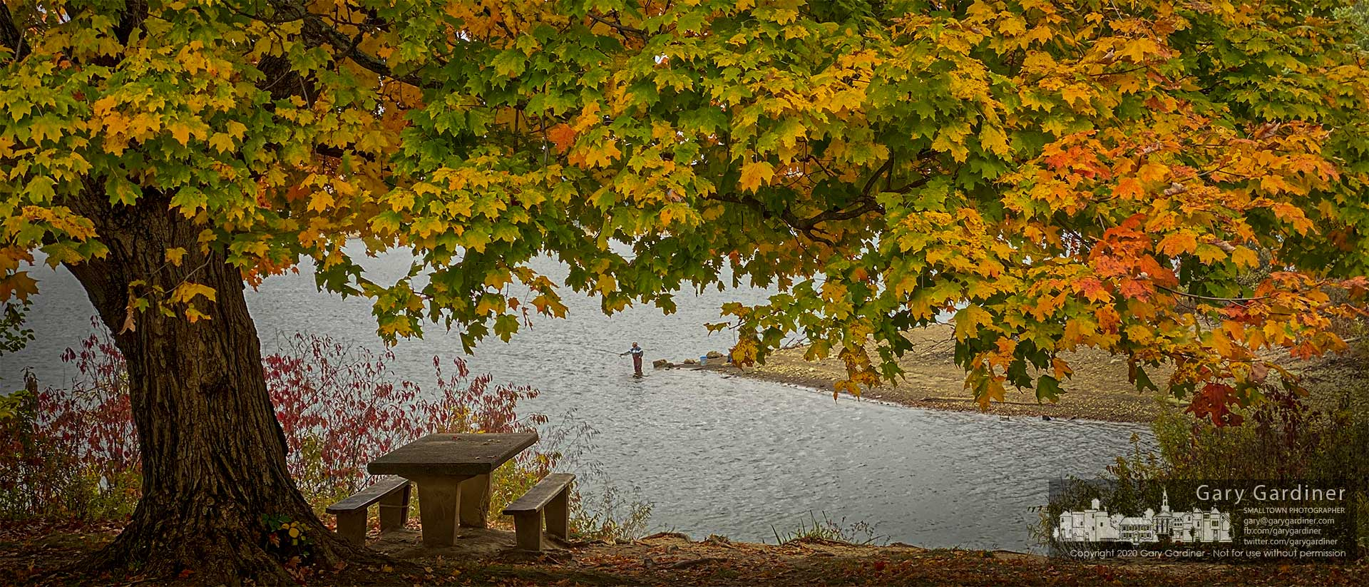 An angler casts his bait into the low waters of Hoover Reservoir under a nearby canopy of trees reflecting the colors of fall. My Final Photo for Oct. 11, 2020.