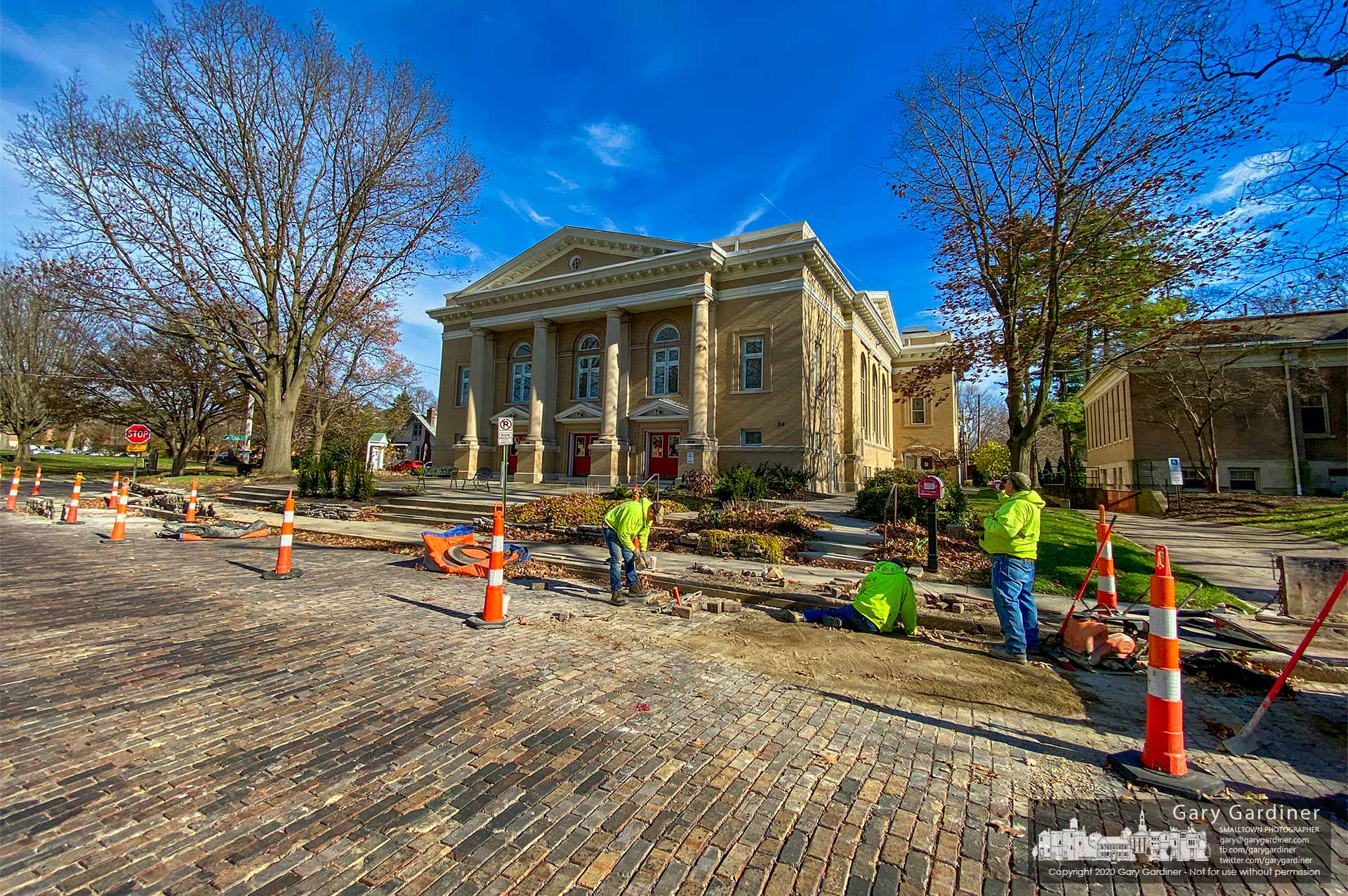 A work crew returns brick pavers to a section of Grove Street after making repairs to the damaged and uneven underlayer. My Final Photo for Nov. 19, 2020.