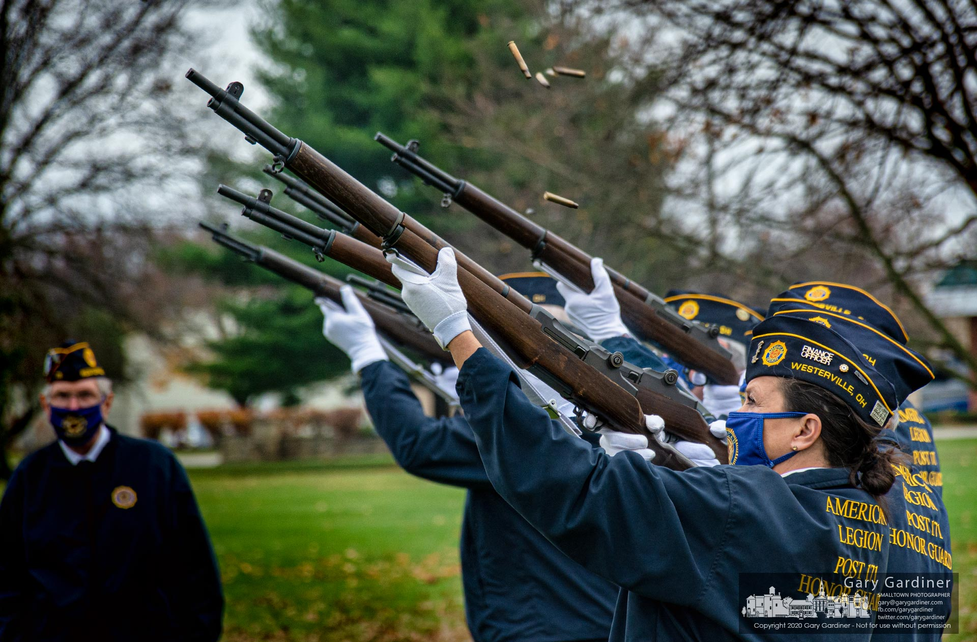 Shell casings fly through the air as the Westerville American Legion Honor Guard fires a 21-gun salute during dedication ceremonies for a new veterans ossuary at Northlawn Cemetery. My Final Photo for Nov. 11, 2020.