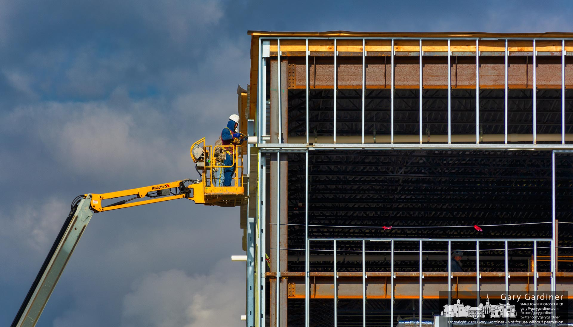A construction worker attaches a section of waterproof sheathing to the west wall of the COPC medical building being built at the company's headquarters on Africa Road. My Final Photo for Nov. 23, 2020.