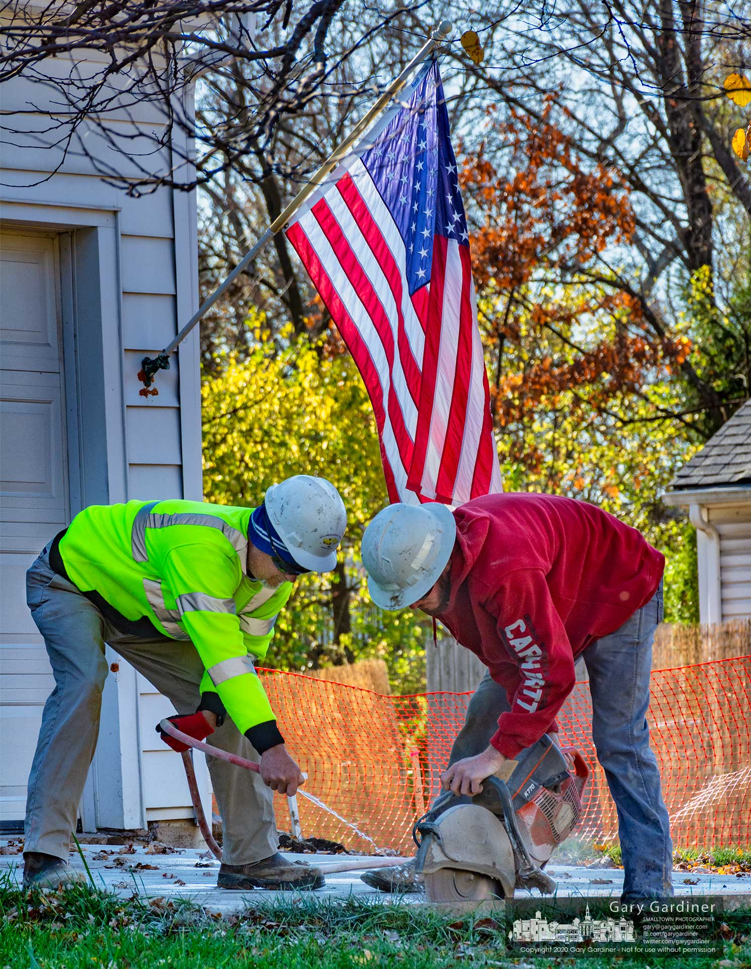 Contractors trim the end of a slab of concrete preparing it for a new slab to replace a section of driveway removed during upgrades on Russell Street in Westerville. My Final Photo for Nov. 12, 2020.