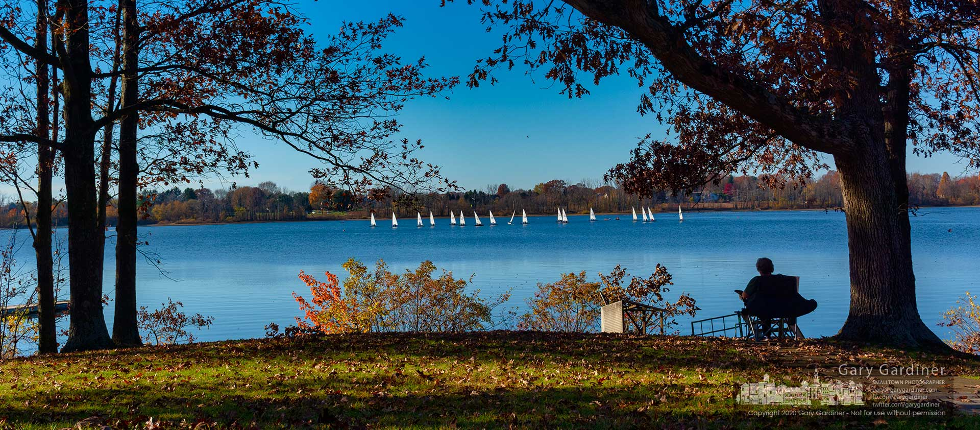 A woman watches as sailors navigate their way around buoys marking their course for a Sunday afternoon of racing and lessons on Hoover Reservoir. My Final Photo for Nov. 8, 2020.