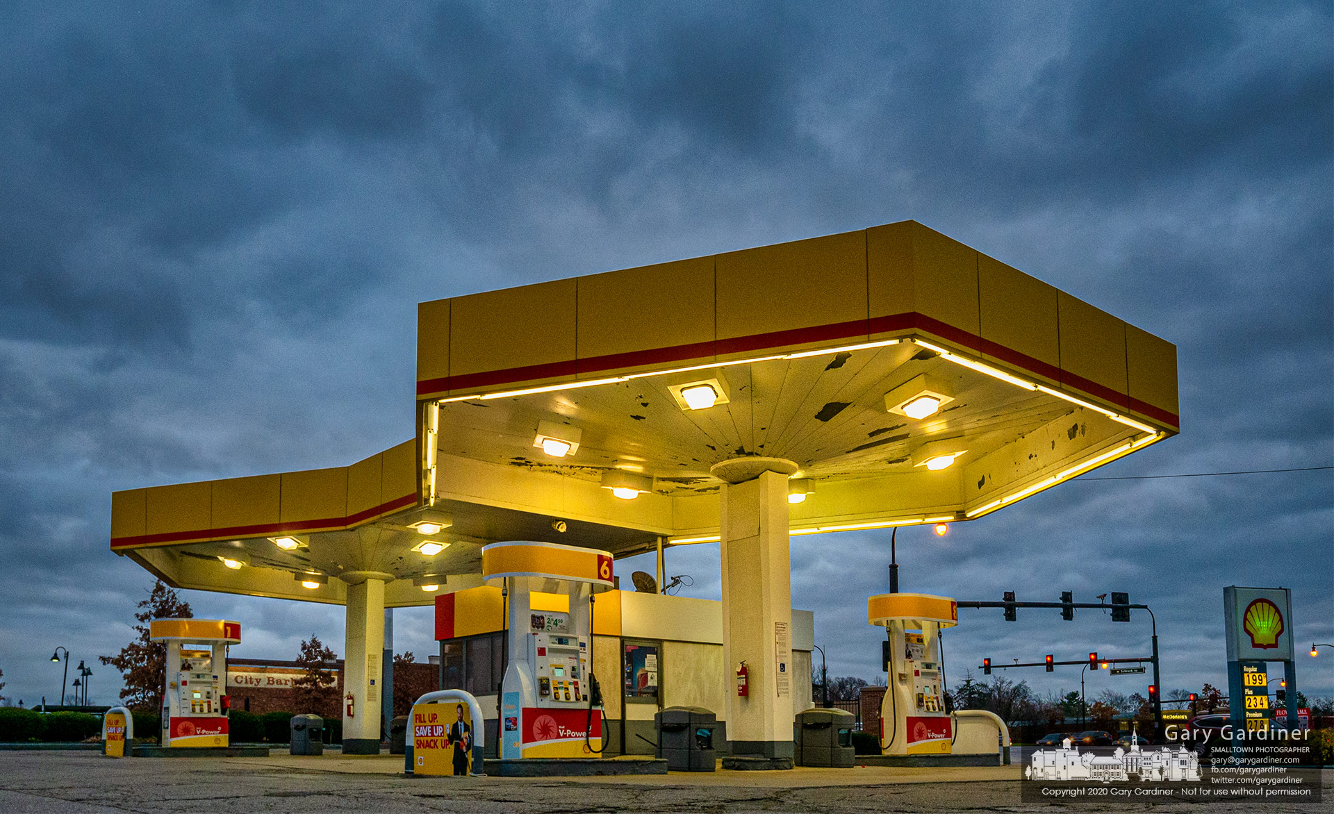 The Shell gas station at Schrock and South State is brightly lit in the late afternoon light marking it is open for business on Thanksgiving day. My Final Photo for Nov. 26, 2020.