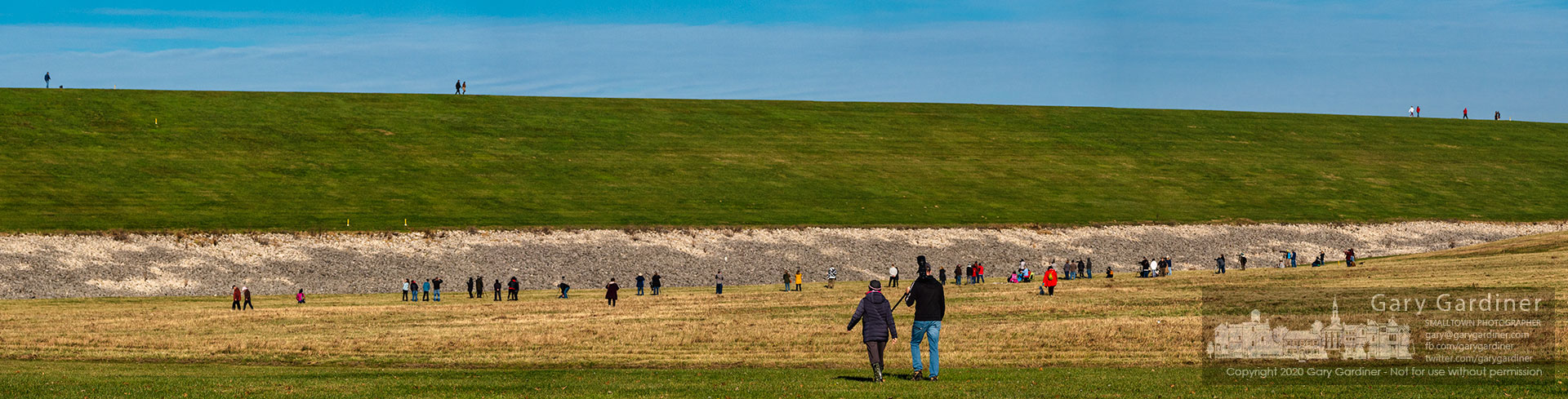 Photographers and friends of fowl gather below the Alum Creek Dam to observe and photograph a snowy owl that began visiting the structure earlier this week. My Final Photo for Nov. 29, 2020.