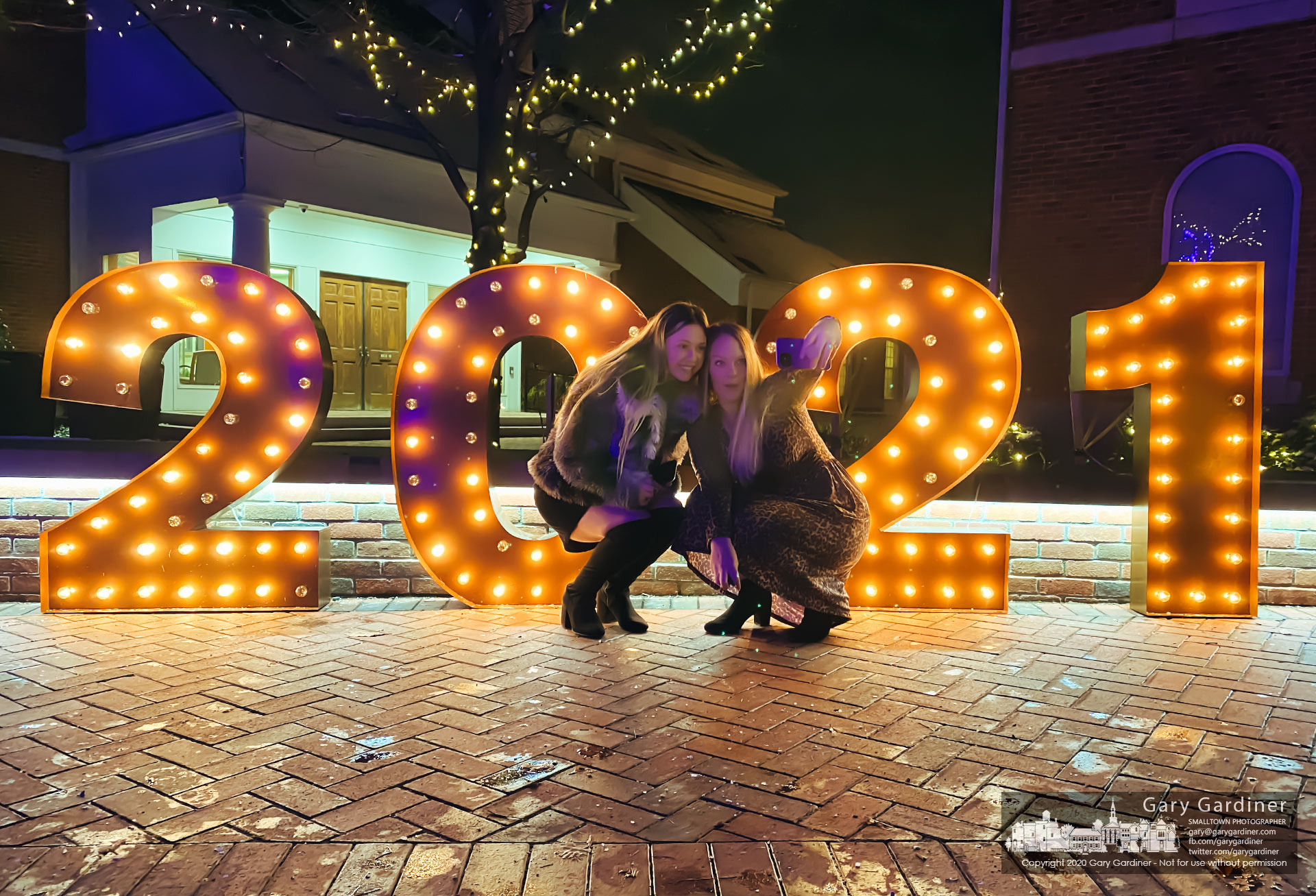 A mother and daughter pose for a selfie in front of the lighted 2021 signs placed in front of city hall in Westerville. Ohio. My Final Photo for Dec. 31, 2020.
