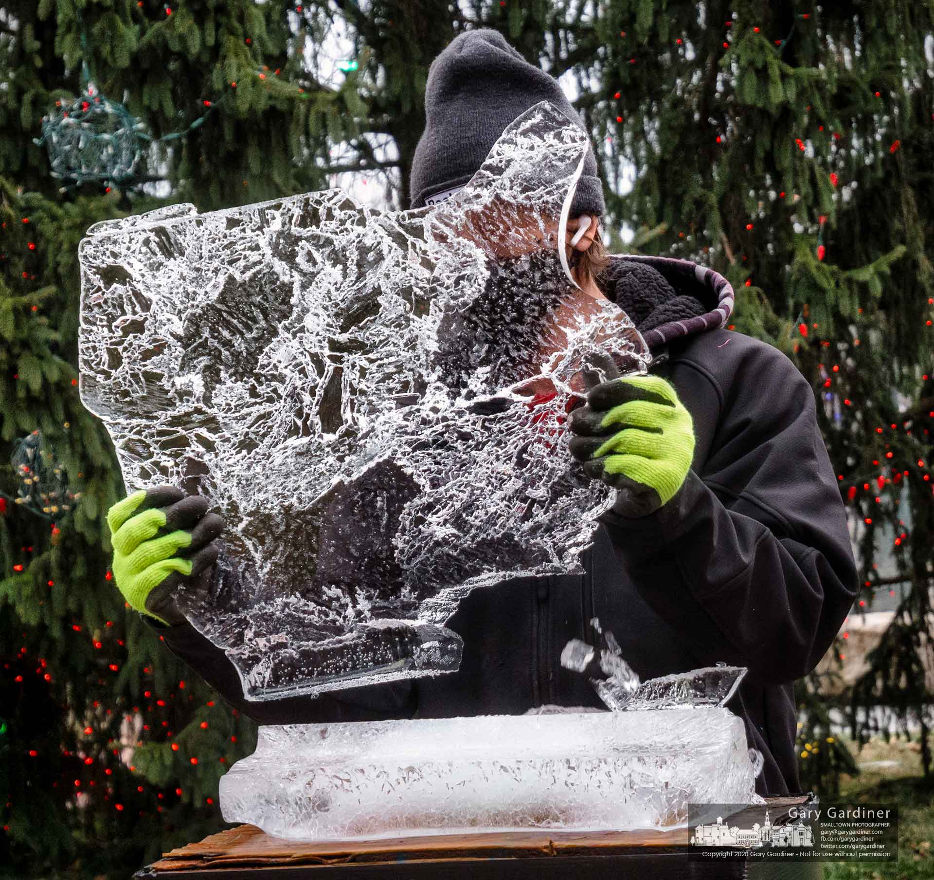 One of the ice sculptures in front of Westerville city hall is removed from its stand after, with its companion sculptures, spending the weekend adorning the Uptown area for the final weekend of shopping before Christmas. My Final Photo for Dec. 22, 2020.