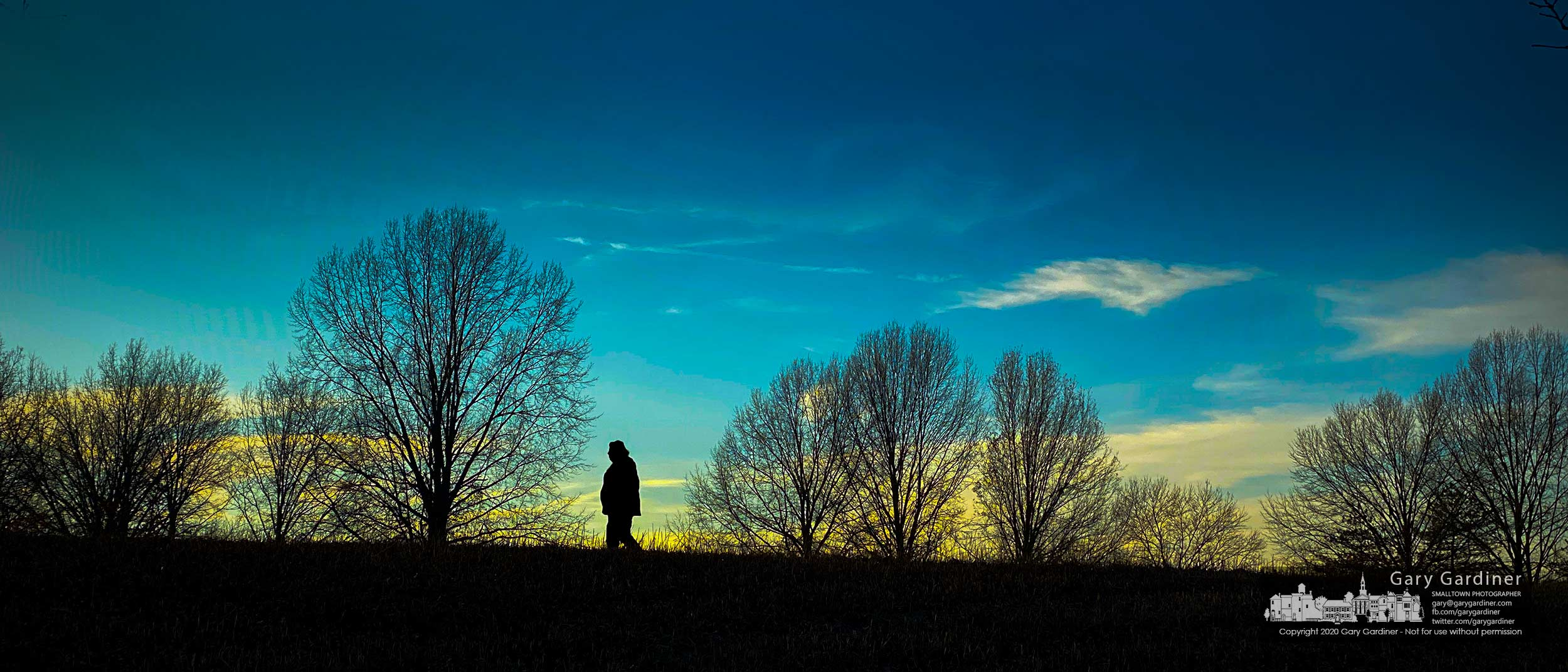 A woman crosses against the horizon illuminated by Thursday's sunset in Sharon Woods Park. My Final Photo for Dec. 10, 2020.