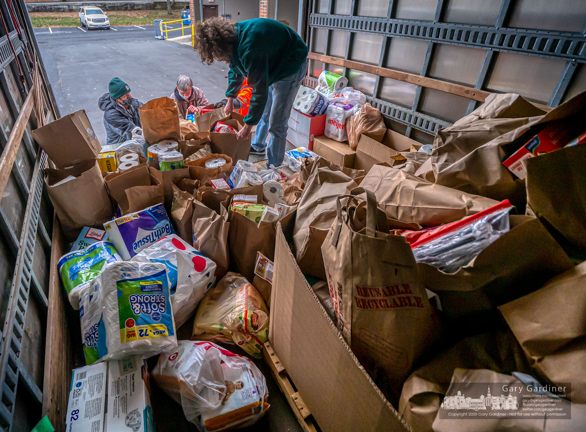 Workers and volunteers unload the final truck of food donated to W.A.R.M. where the annual food drive collected 60,000 poi=unds of food more than doubling last year's amount. My Final Photo for Dec. 5, 2020.