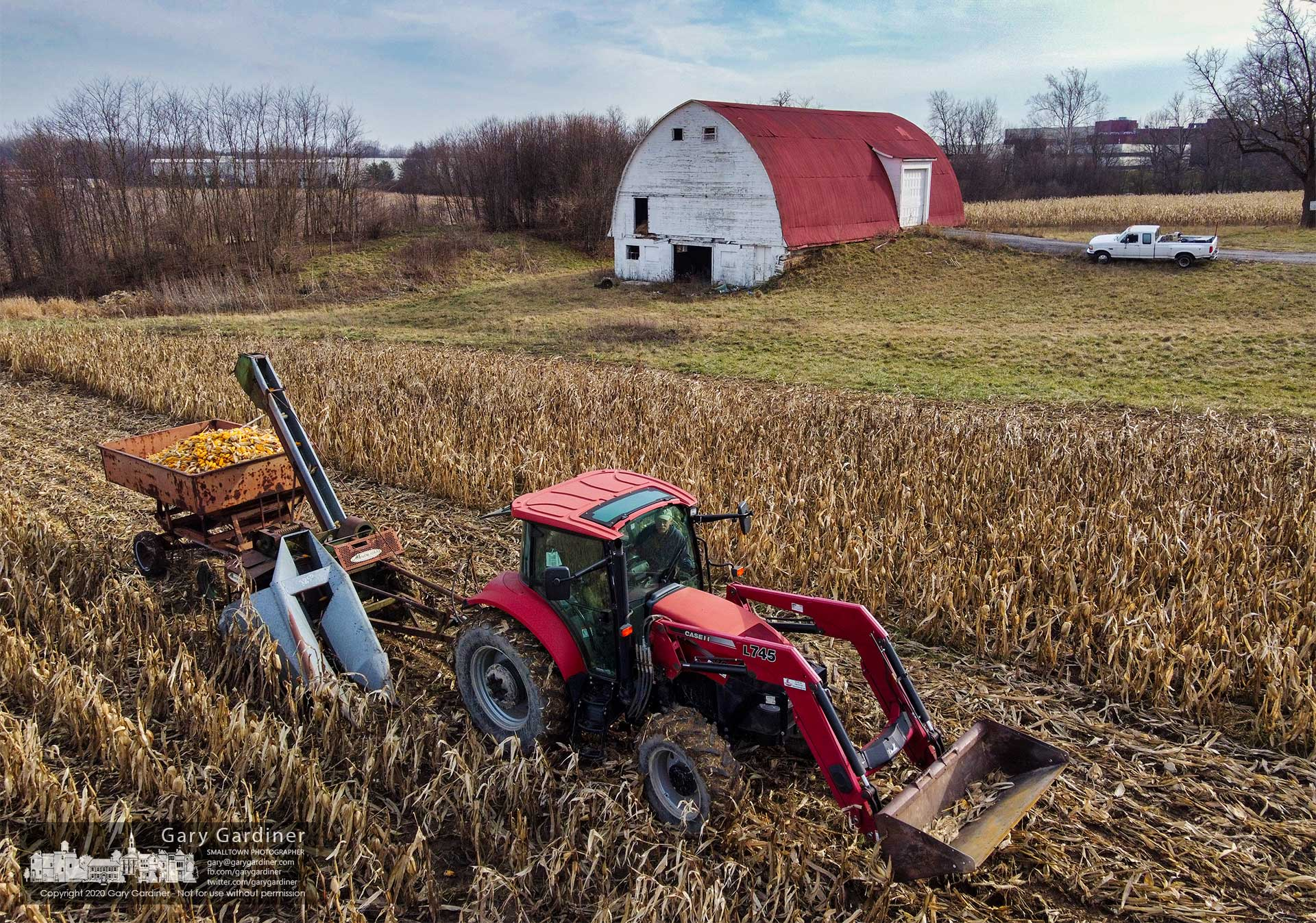 Kevin Scott runs a single row corn picker through the fields at the Braun Farm completing the season of corn for the year. My Final Photo for Jan. 14, 2021.