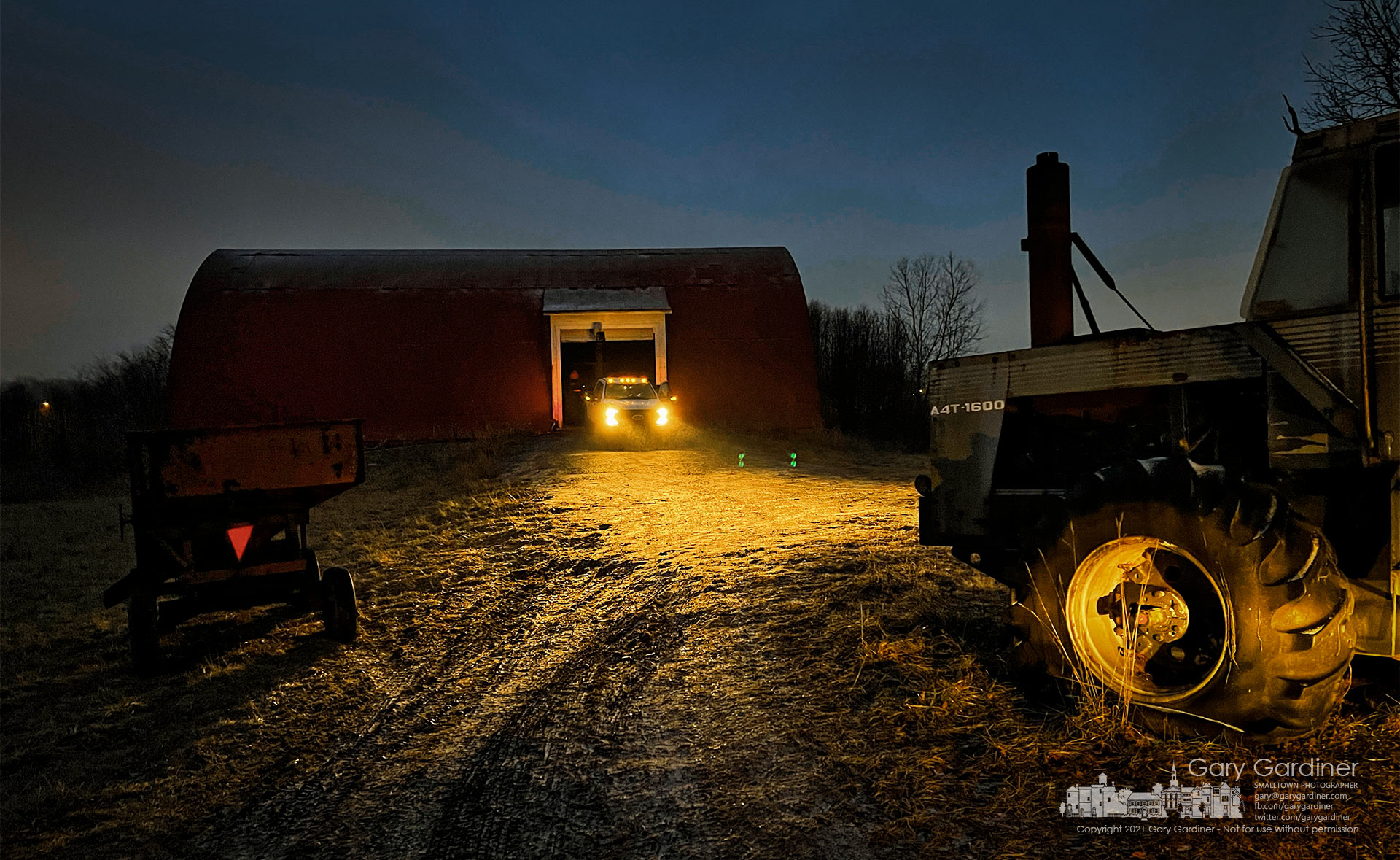 A truck's light brightens the road in front of the Braun Farm where the corn picker continues to be repaired. My Final Photo for Jan. 24, 2021.