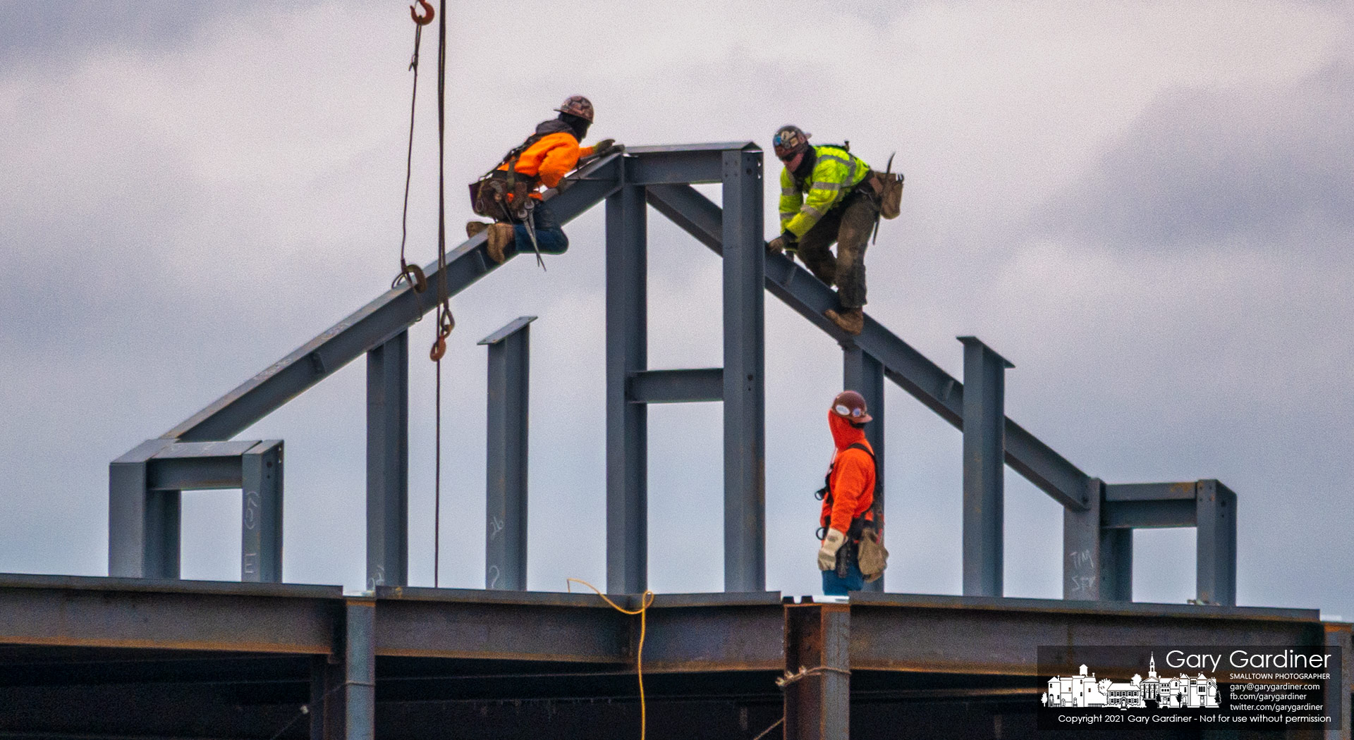 A pair of steelworkers attach struts to beams at the top of the new health care facility under construction at the corner of County Line and Africa Roads. My Final Photo for Jan. 27, 2021.