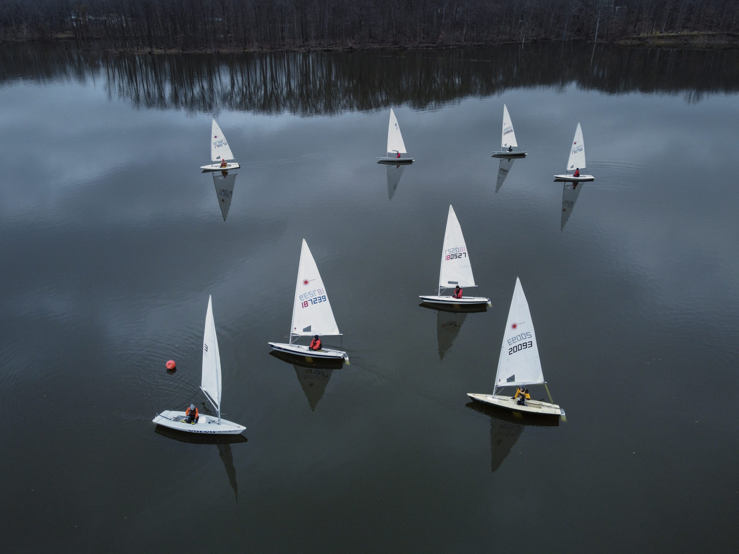 Sailors from the Hoover Sailing Club slowly navigate their way around buoys marking the racecourse where they competed on a day with little wind but still waters. My Final Photo for Jan 2, 2021.