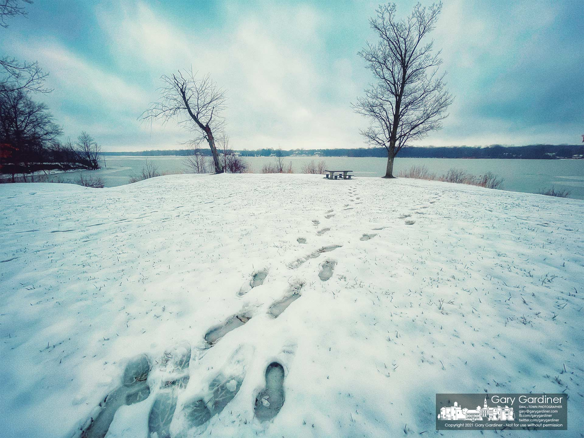 A set of footprints in the fresh snow leads to and from the shoreline at Hoover Reservoir. My Final Photo for Jan. 31, 2021.