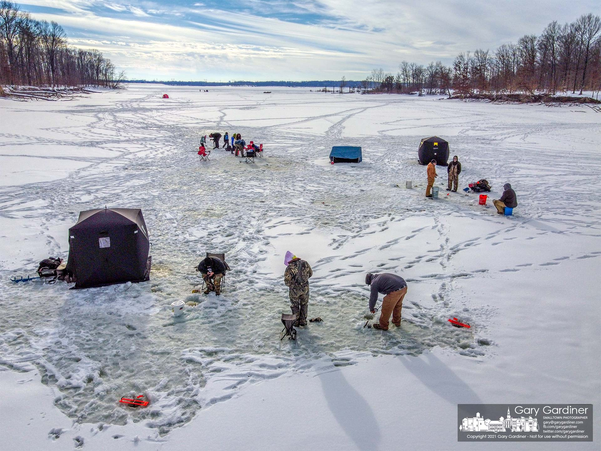 A group of anglers sets their lines and tents on thick ice on a small lagoon on Alum Creel Lake on Sunday as temperatures are forecast to warm up during the week. My Final Photo for Feb. 21, 2021.