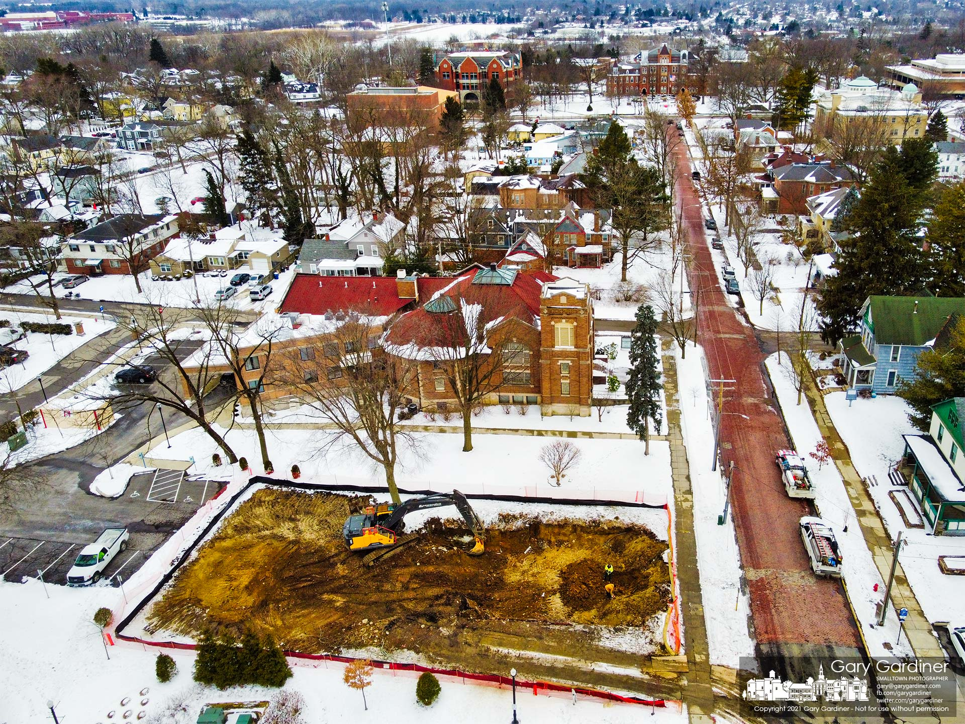 A demolition crew clears the ground after demolishing a house behind city hall to make way for a parking lot expansion. My Final Photo for Feb. 5, 2021.