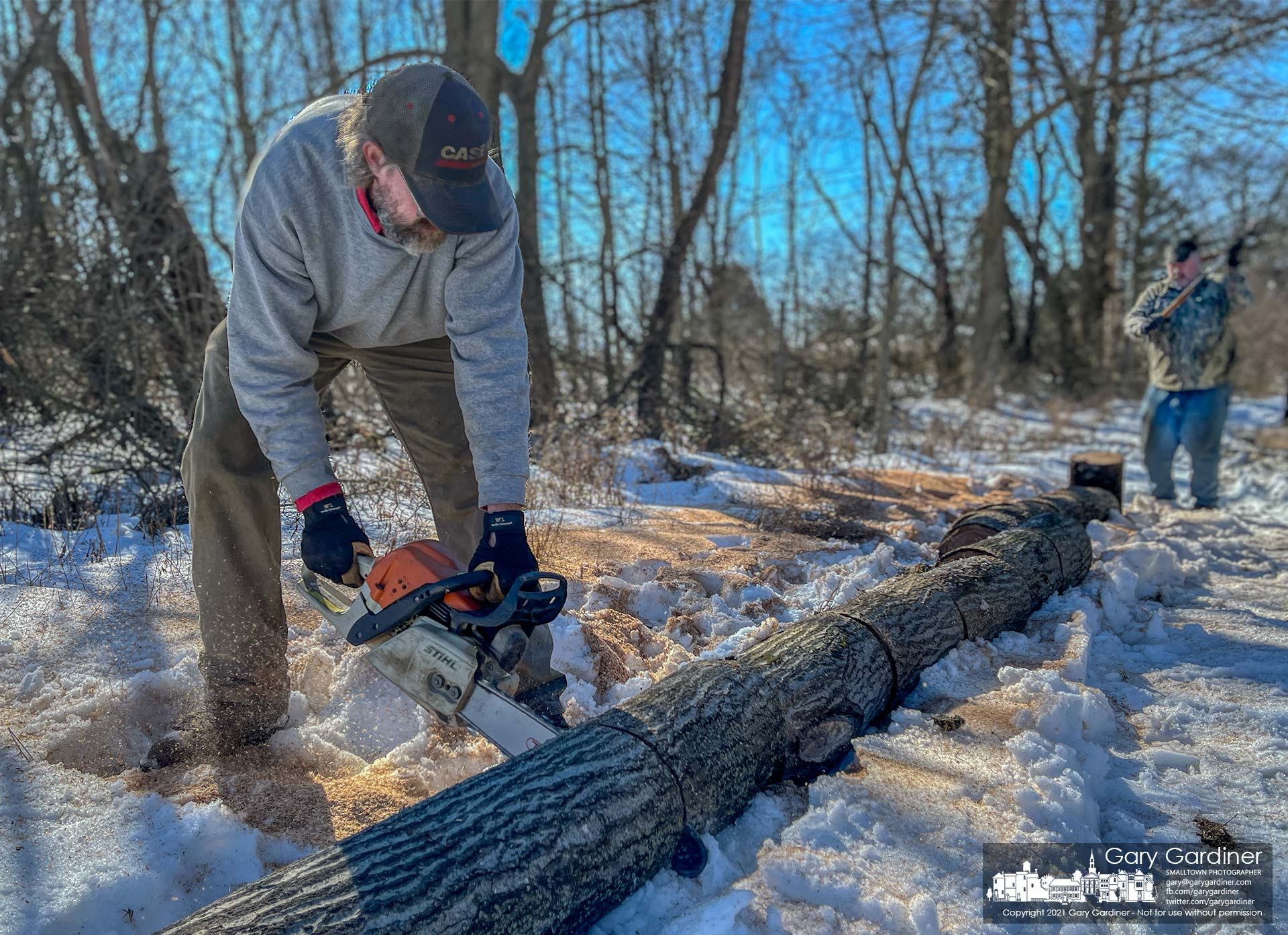 Rodney Parker and Kevin Scott cut and split firewood harvested from a field on Africa Road. My Final Photo for Feb. 23, 2021.
