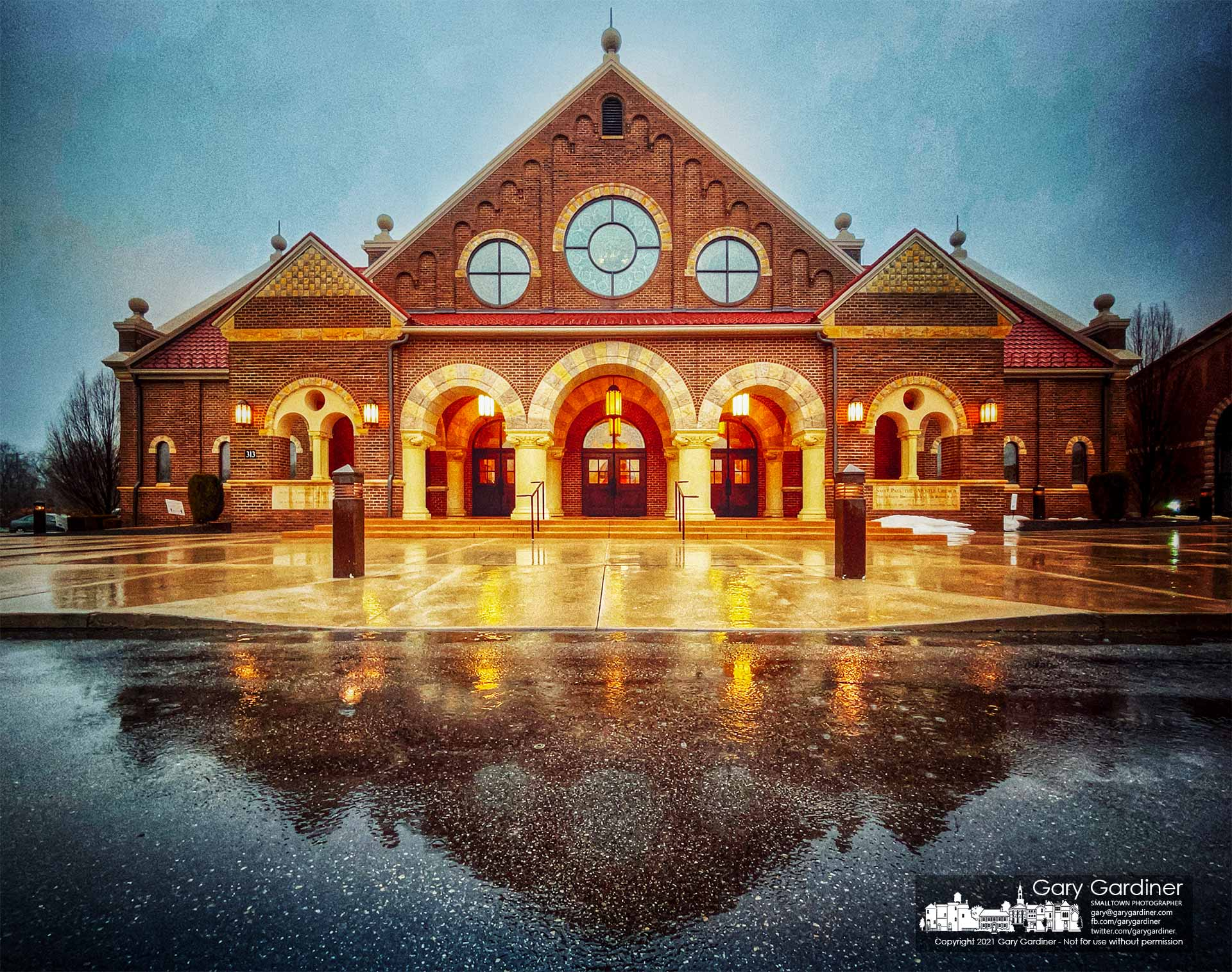 St. Paul the Apostle Catholic Church is reflected in the entrance to the church after an overnight rainstorm. My Final Photo for Feb. 28, 2021.
