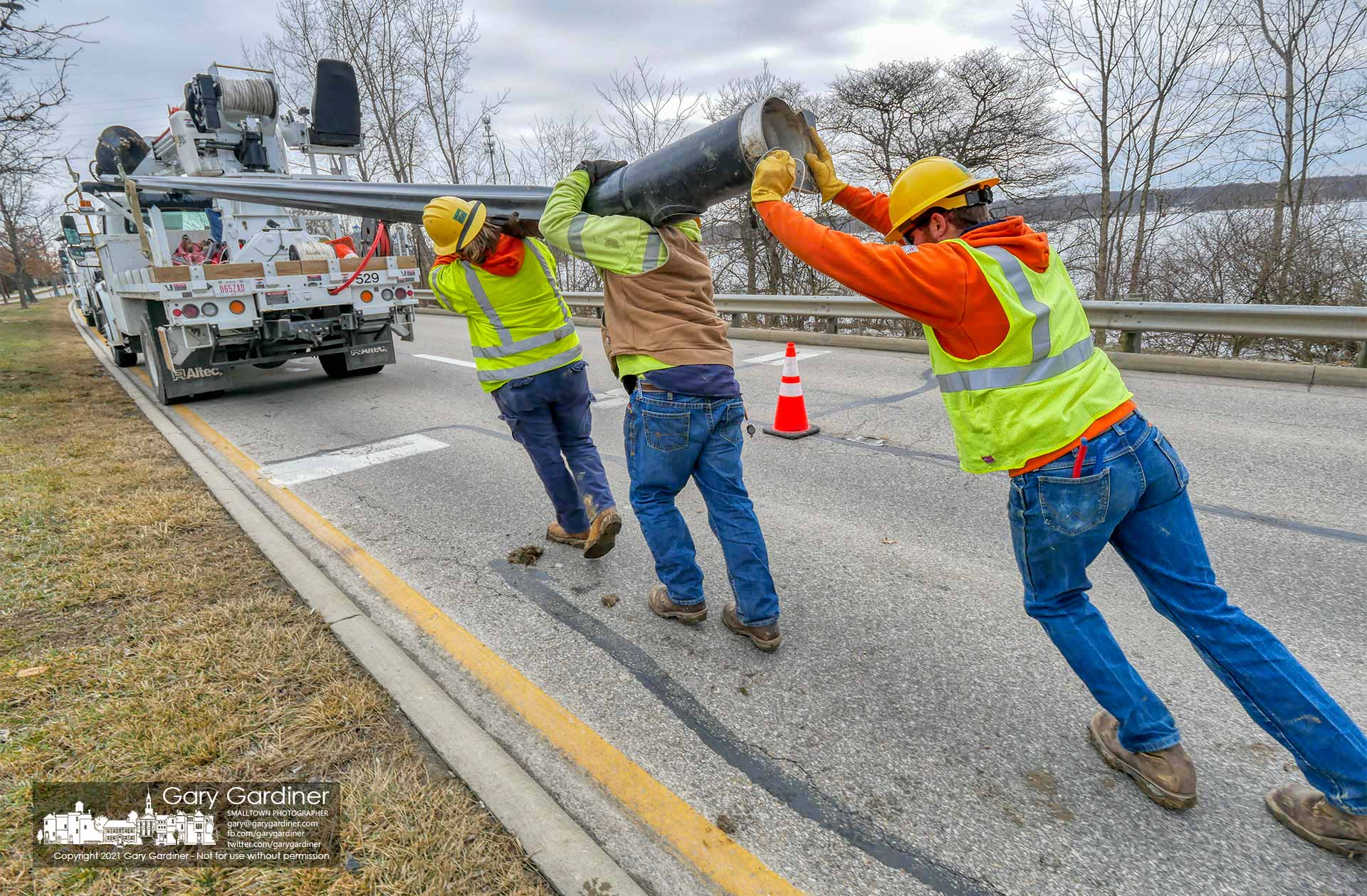 City electric crews remove a streetlight pole that was broken at its base recently in a car crash on Sunbury Road near East College. Ave. My Final Photo for Feb. 24, 2021.