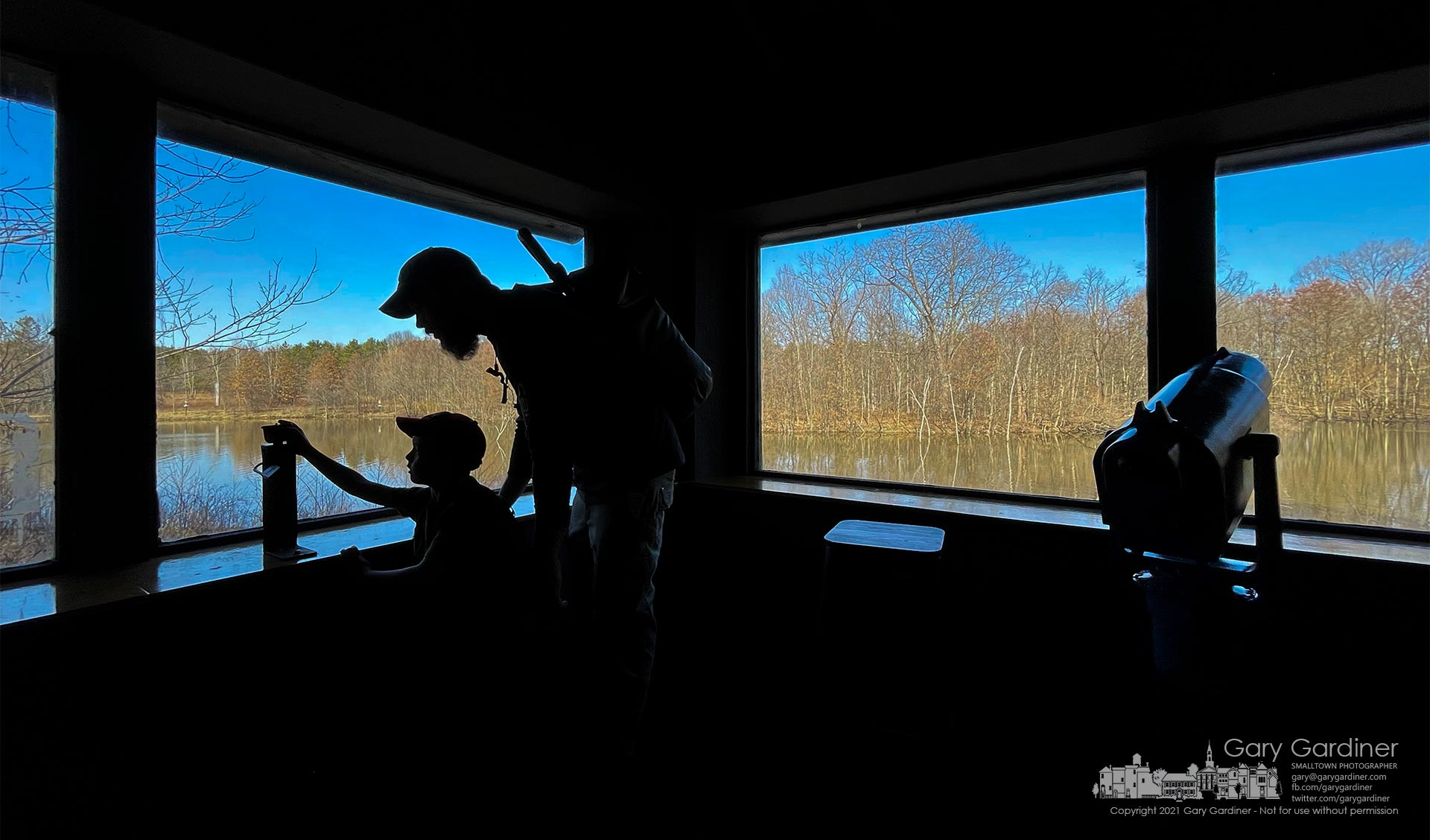 Father and son inspect a camera mount in the observation stand at Thoreau Pond in Blendon Woods Metro Park on Sunday afternoon. My Final Photo for March 21, 2021.