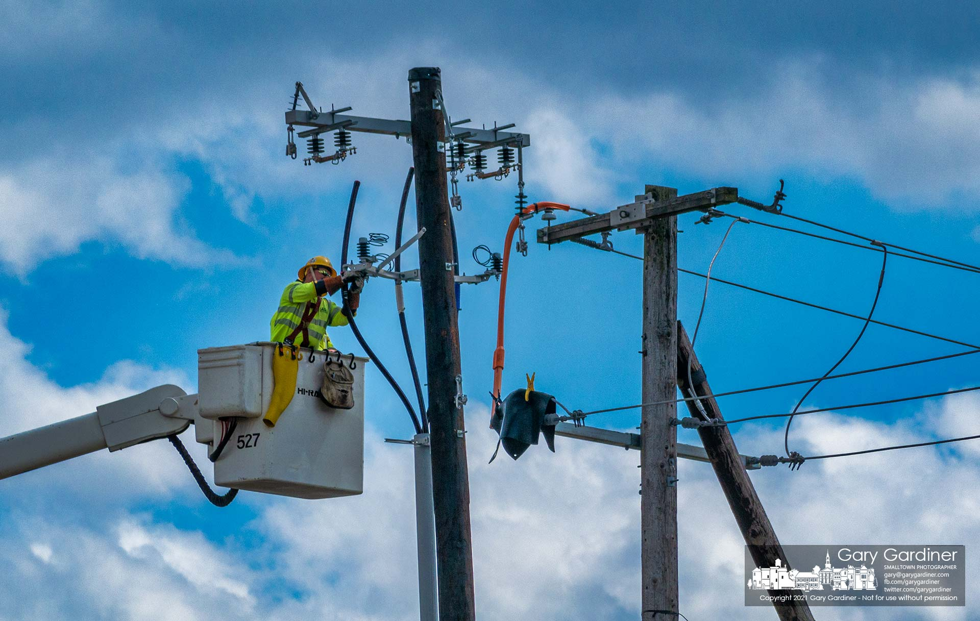 A city electrical worker installs new cables that will direct power underground to the substation being upgraded on Collegeview Ave. My Final Photo for March 24, 2021.