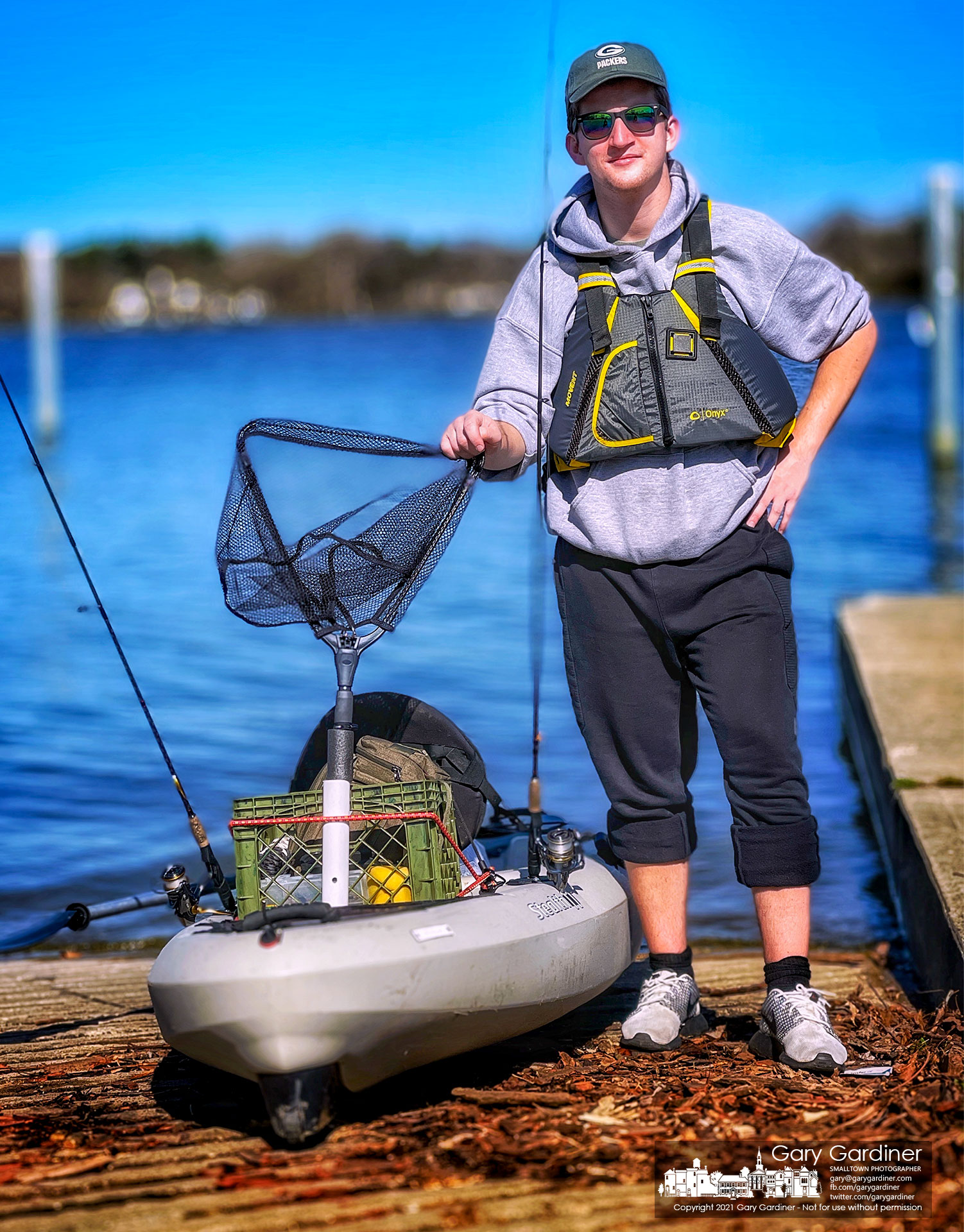 A fisherman poses for a quick photo before launching a borrowed boat on Hoover Reservoir for the first time. My Final Photo for March 27, 2021.
