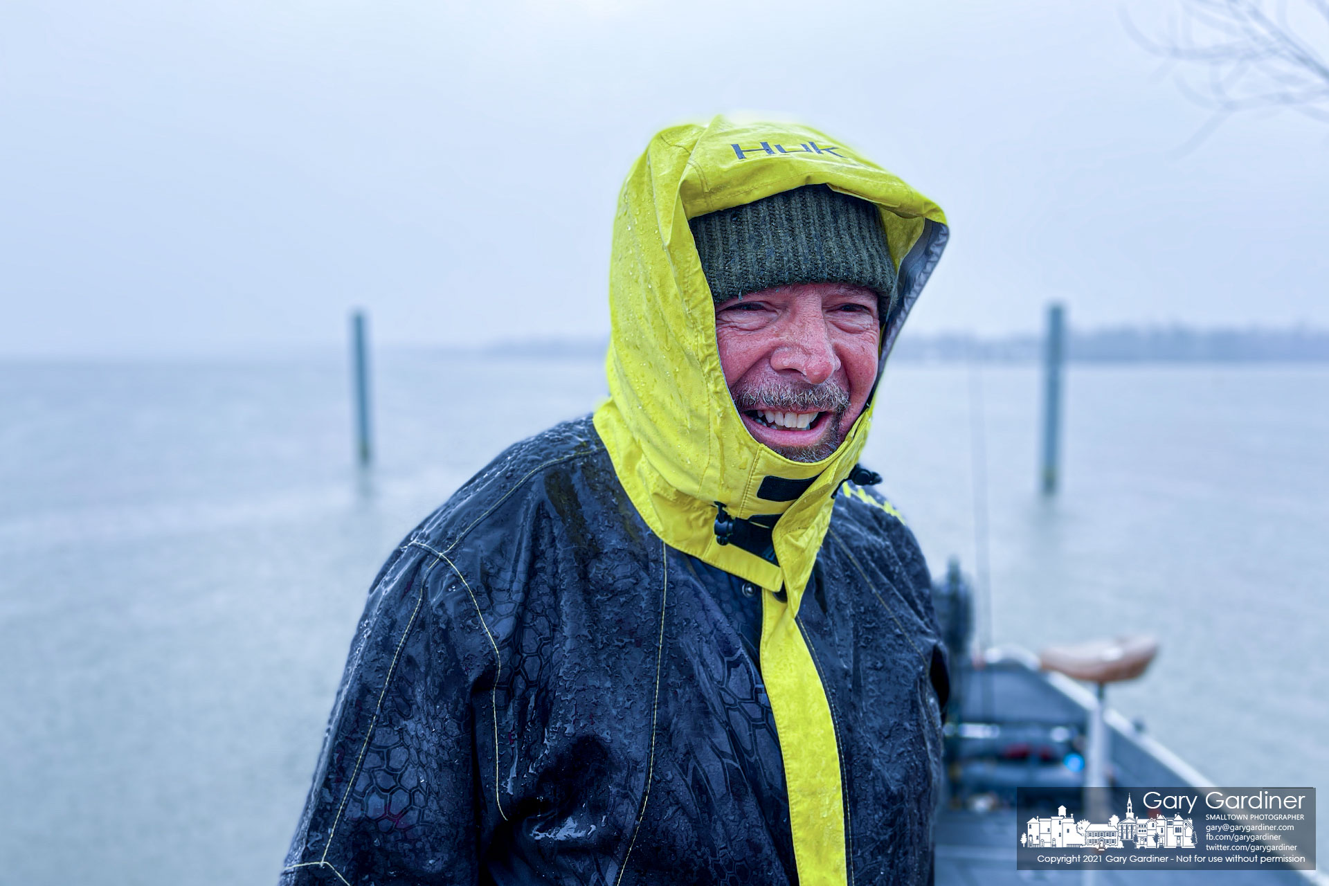 A fisherman smiles after tieing his boat off at the Red Bank boat ramp as he escapes a heavy rain that greeted him after a morning with little success on Hoover Reservoir. My Final Photo for March 11, 2021.
