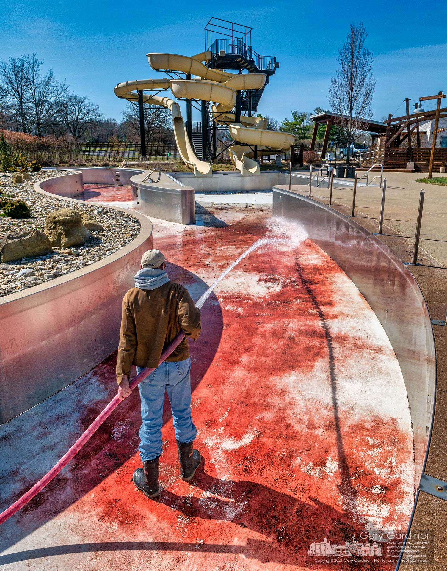 A Westerville Parks and Recreation worker sprays debris and dirt from the lazy river pool at Highlands Aquatic Center in preparation for possible opening this year after the pool stayed closed last year because of the pandemic. My Final Photo for March 22, 2021.