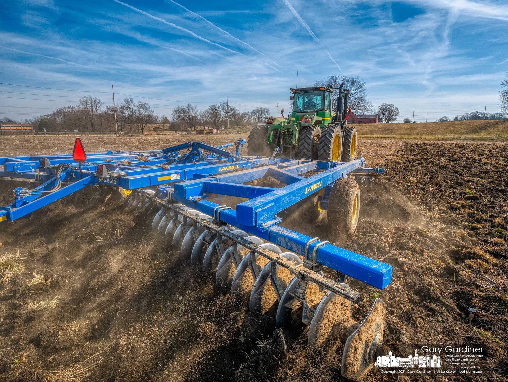 A farmer runs a disc plow over the field beneath the Yarnell Farm on Africa Road preparing for planting of corn after missing last year's planting season because of the heavy rains. My Final Photo for March 10, 2021.