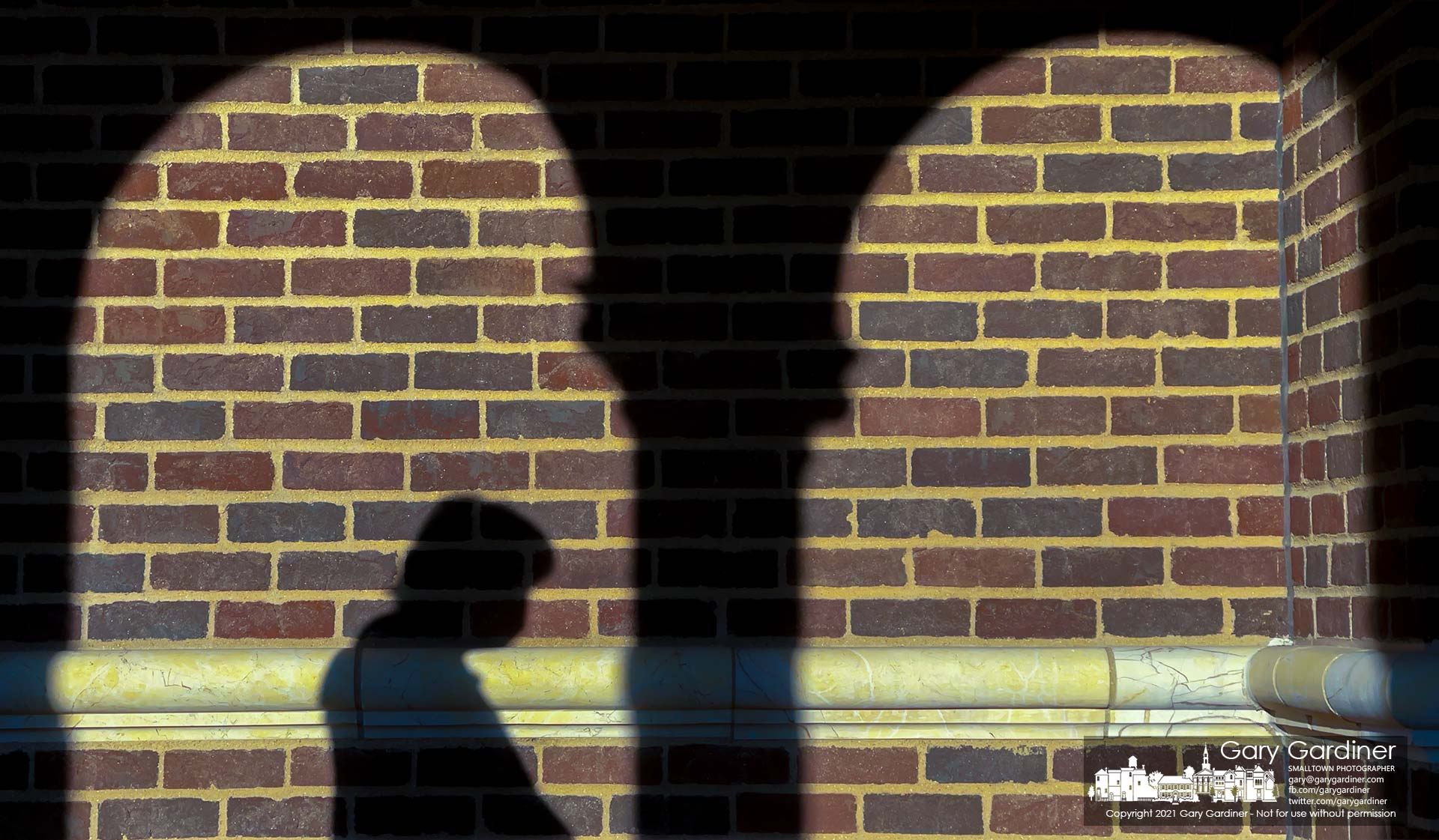 A parishioner's shadow settles on a wall leading into St. Paul the Apostle Catholic Church. My Final Photo for March 7, 2021.