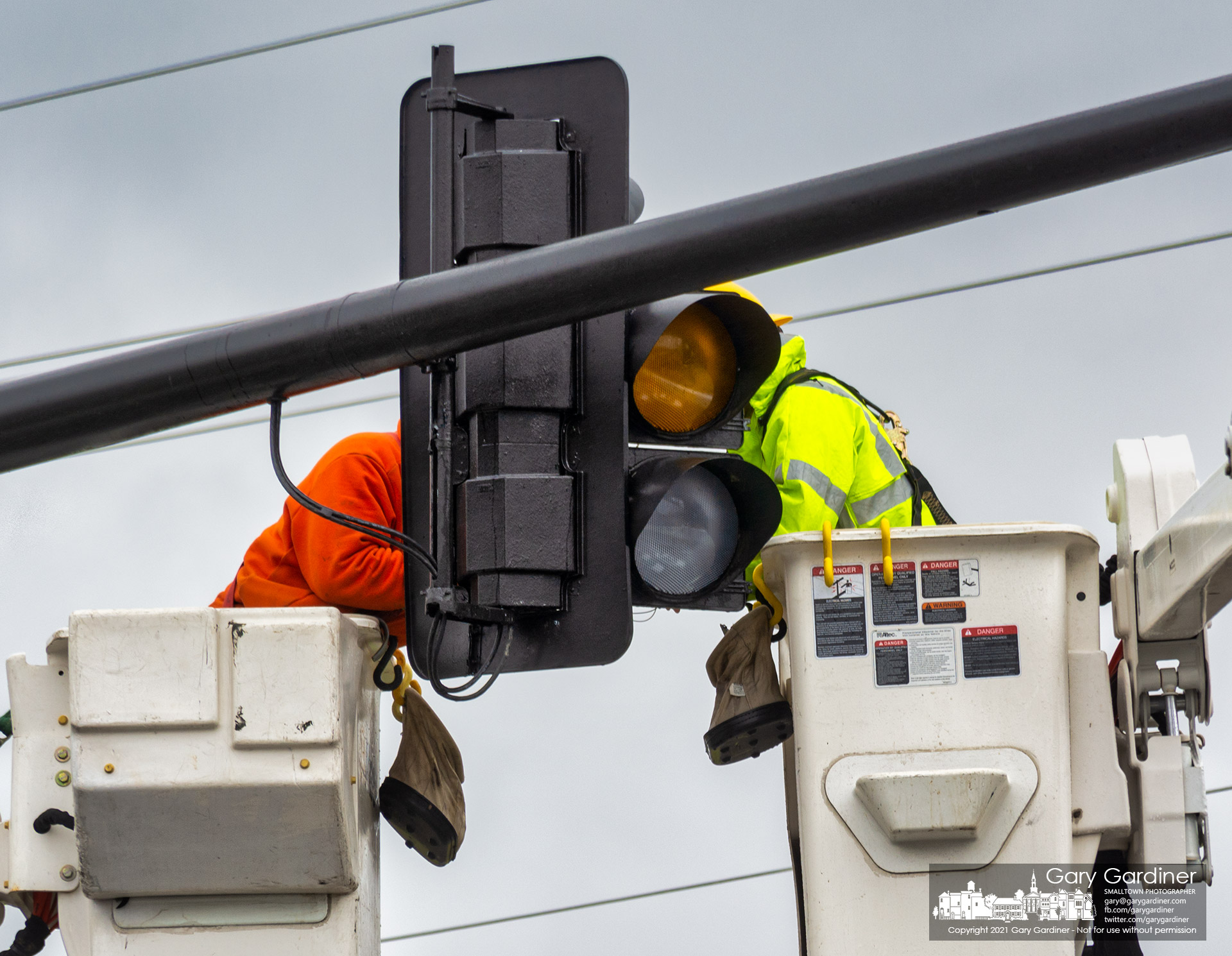 City electric workers complete rewiring a traffic signal that failed during Thursday's rainstorms causing the light to begin four-way flashing. My Final Photo for March 18, 2021.