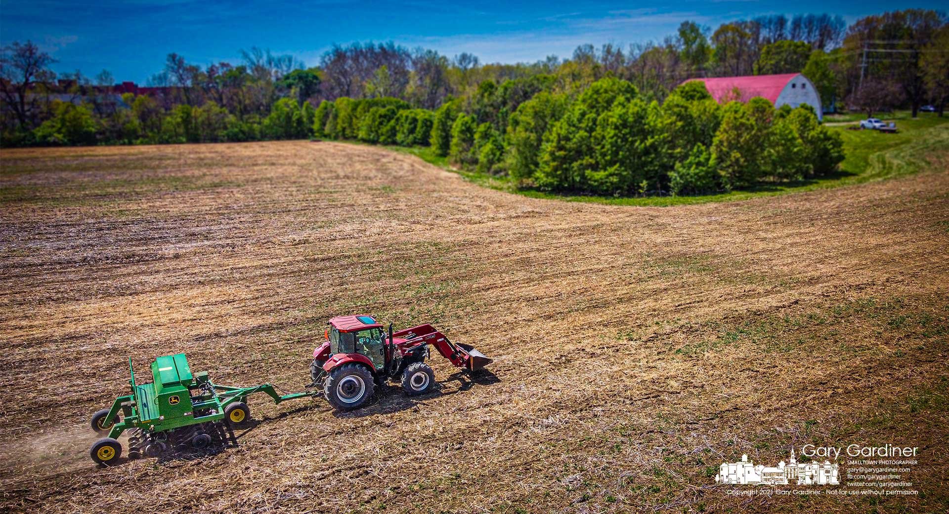 Kevin Scott runs a soybean planter over the fields at the Braun Farm hoping to finish this field and several others before rain starts tomorrow night. My Final Photo for April 27, 2021.