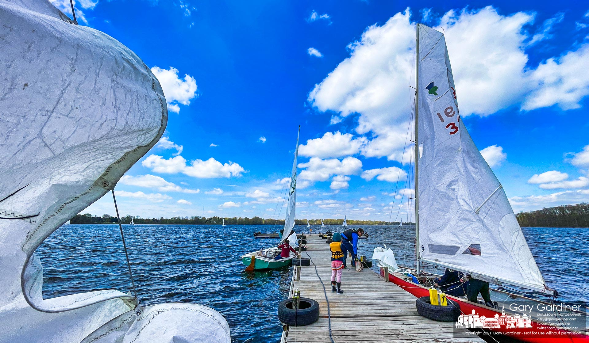 Sailors return to and prepare for launch from the docks at Hoover Sailing Club on a day that brought 30-mph gusts and temperatures in the mid-50s making for brisk sailing. My Final Photo for April 25, 2021.