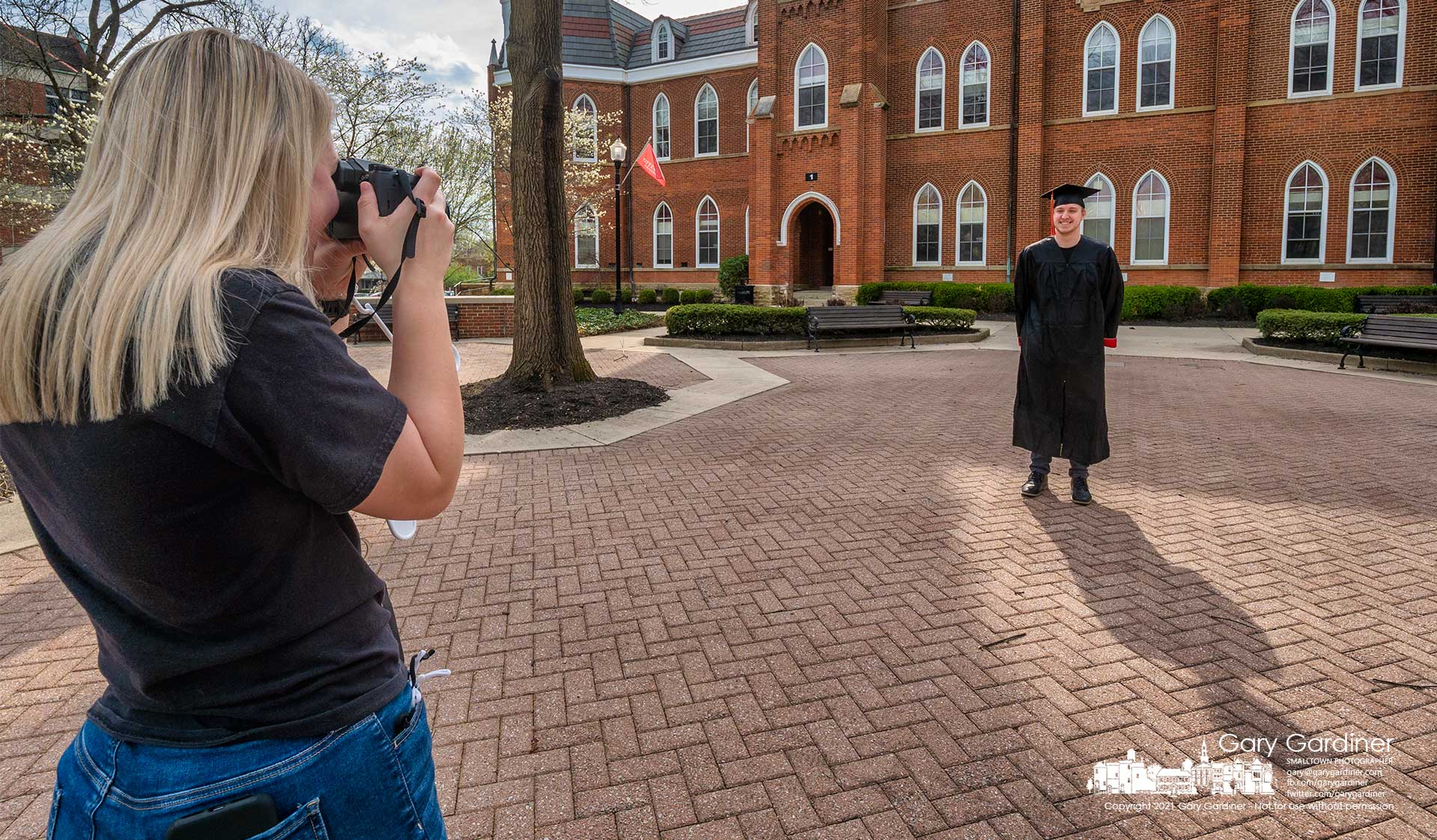 An Otterbein graduating senior poses for his fiance in front of Towers Hall as he prepares for commencement ceremonies in May. My Final Photo for April 7, 2021.