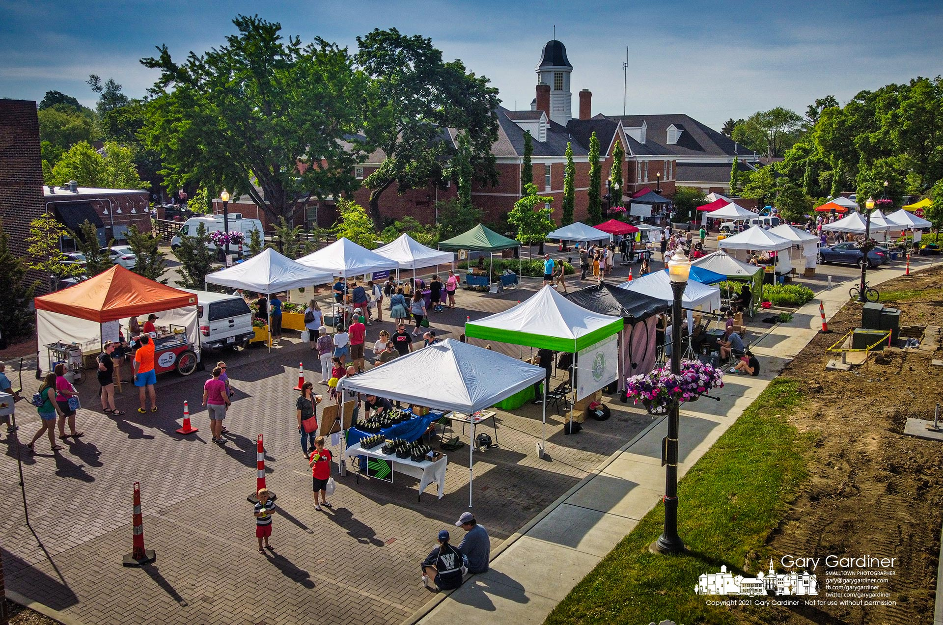 The first Saturday Farmers Market opened behind city hall to warm temperatures, a large number of vendors, and a crowd eager to see the market begin another year of summer treats. My Final Photo for May 22, 2021.