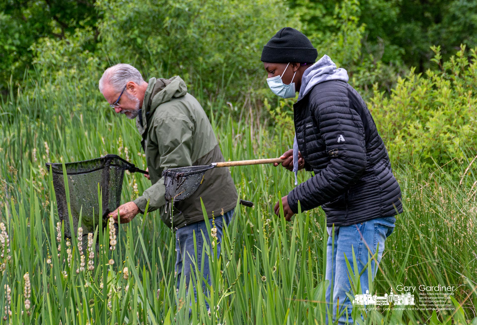 MAD Scientist's Mark Dilley, left, helps a young explorer discover the amphibian and fishes of the Highland Wetlands during the annual Wetland Workshop Saturday morning. My Final Photo for May 29, 2021.