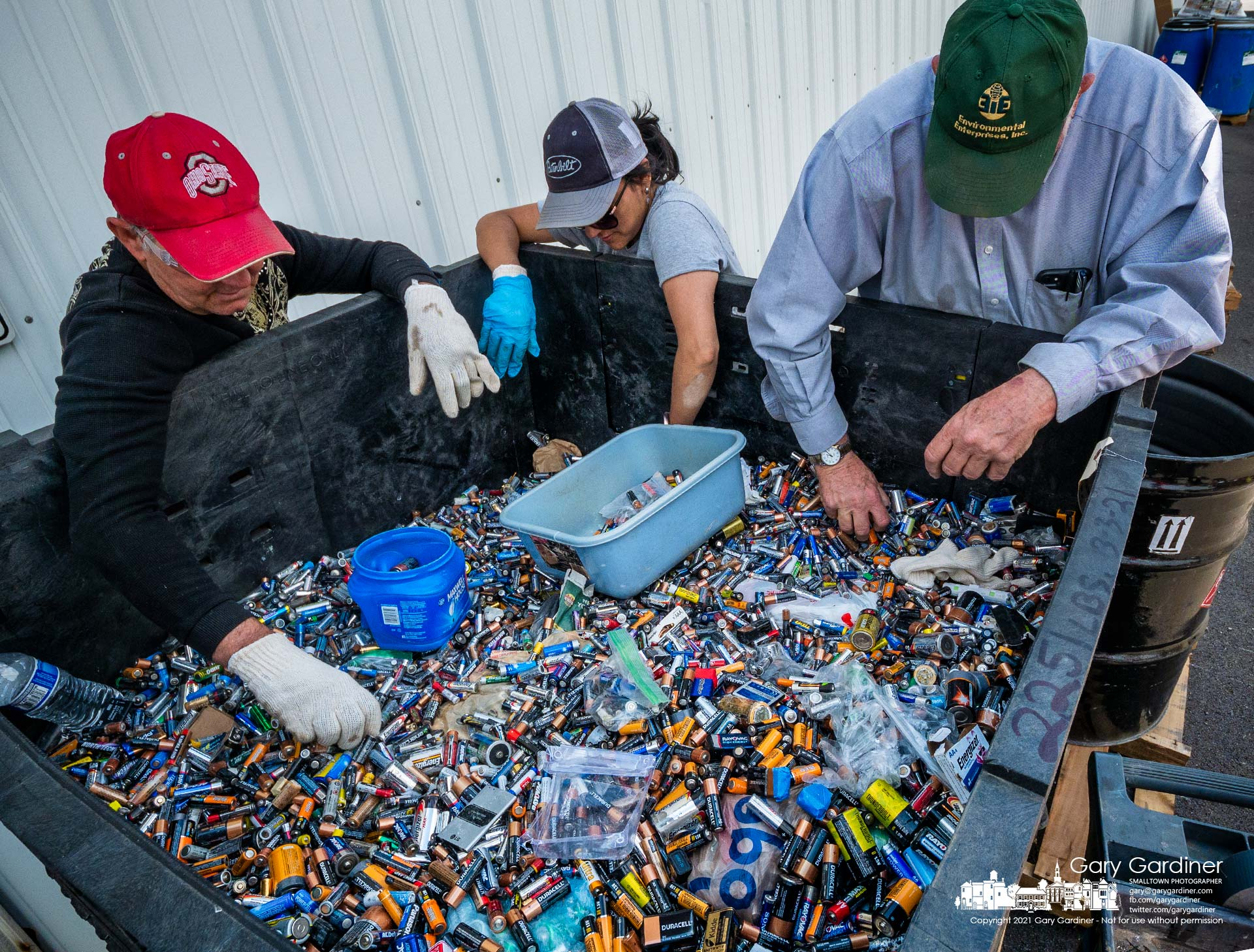 Sorters remove lithium batteries from a bin holding a portion of the batteries left for recycling during the Household Hazardous Waste Disposal drive-thru Saturday. My Final Photo for May 15, 2021.