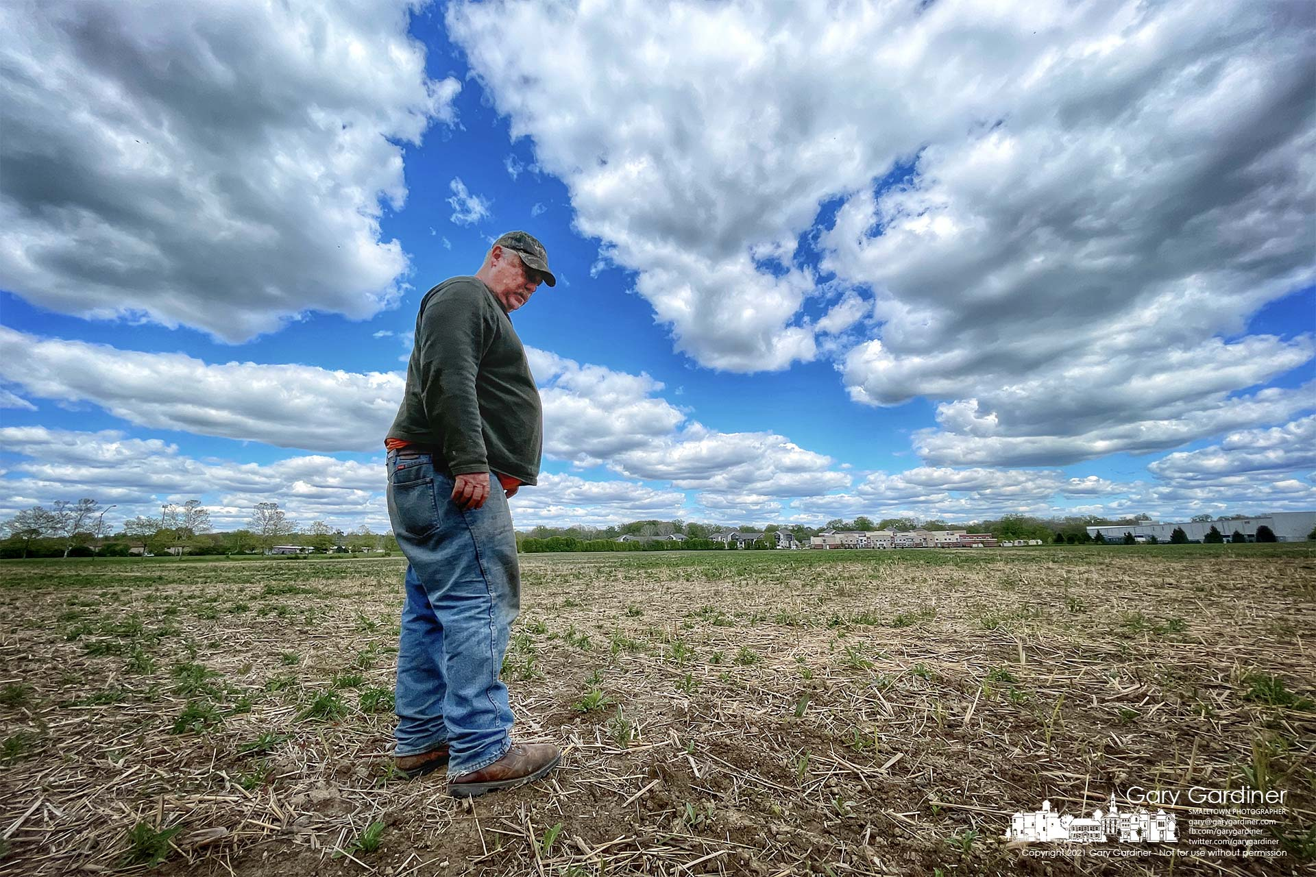 Kevin Scott surveys the Spring growth of weeds and the progress of the soybean seeds he planted two weeks ago on the fields at the Braun Farm. My Final Photo for May 12, 2021.