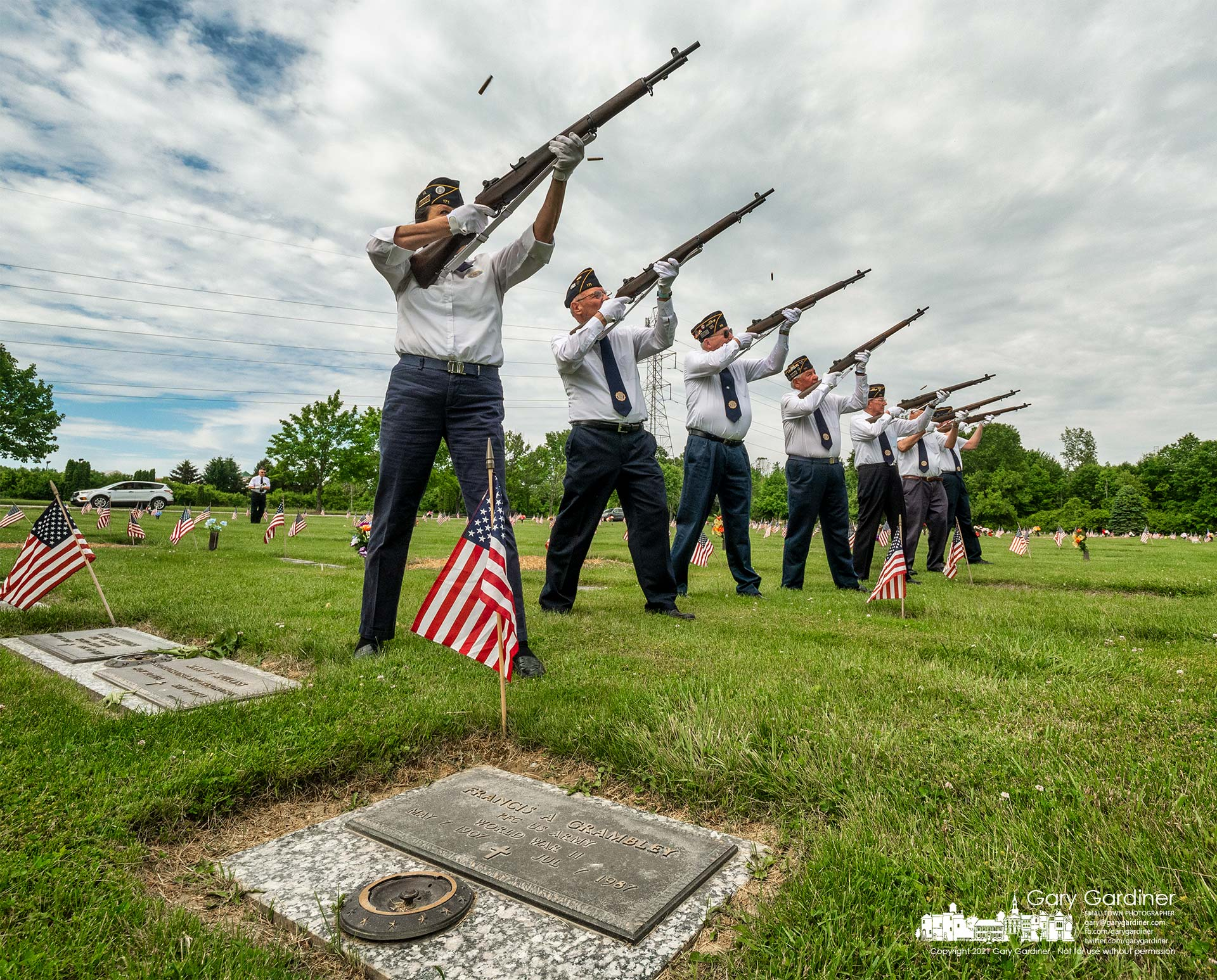 The Westerville American Legion Honor Guard fires a salute during ceremonies at Northlawn Cemetery, one of three cemeteries the veteran group visited on Memorial Day despite not being issued a permit by the city for its annual march and observances. My Final Photo for May 31, 2021.