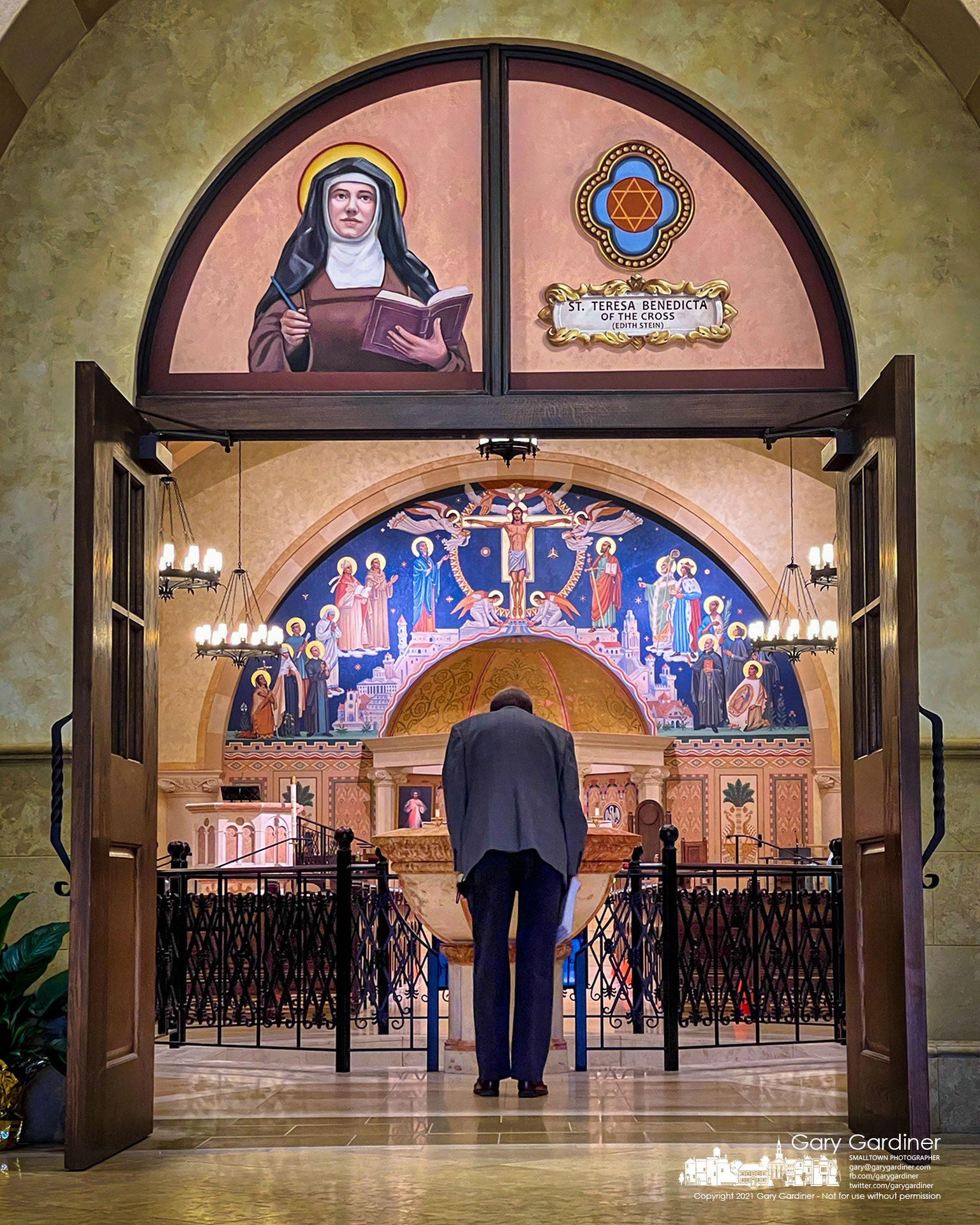 A parishioner bows as he enters St. Paul the Apostle Catholic Church for early Sunday Mass. My Final Photo for May 16, 2021.