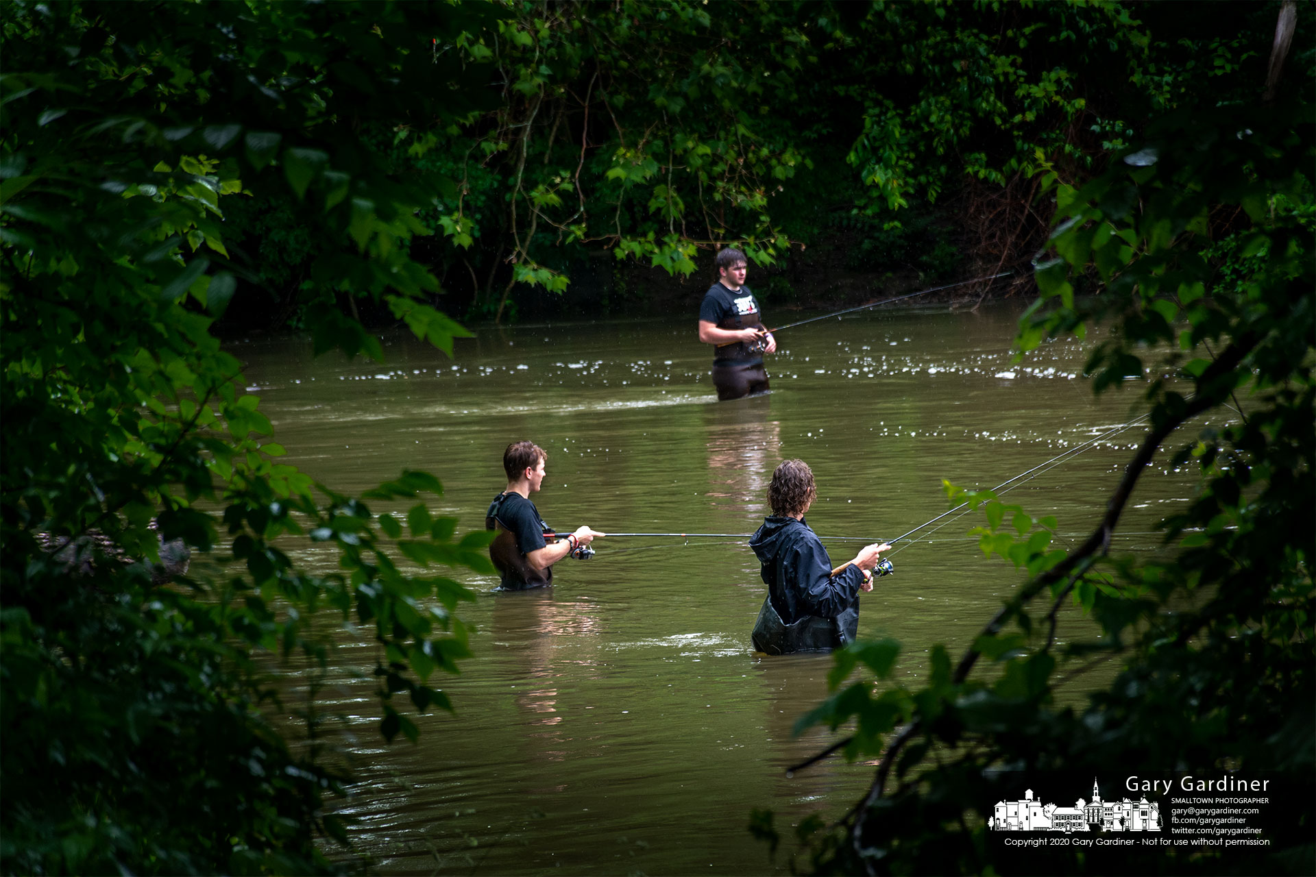 A trio of fishermen try their luck at fishing and navigating the higher than normal rushing waters below the dam at Alum Creek Park in Westerville. My Final Photo for June 9, 2021.