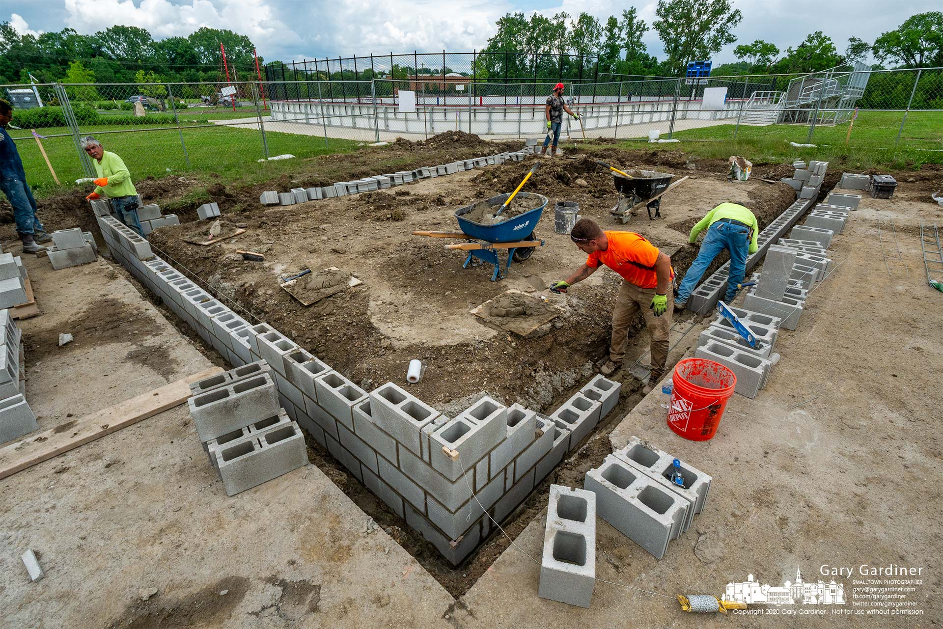 Masons build concrete block walls for a storage and work shed at Alum Creek Park South where the BMX bike path is being upgraded. My Final Photo for June 10, 2021.