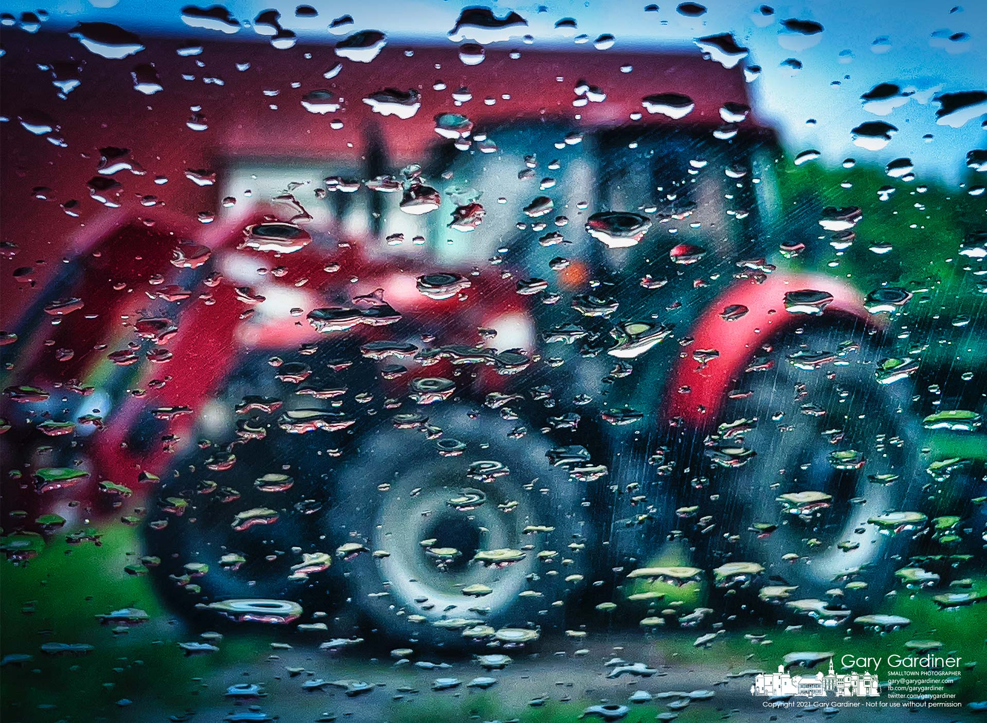 Raindrops on a car windshield mark the difficulty for plans to plow and replant the fields at the Braun Farm on a very wet Monday. My Final Photo for June 7, 2021.