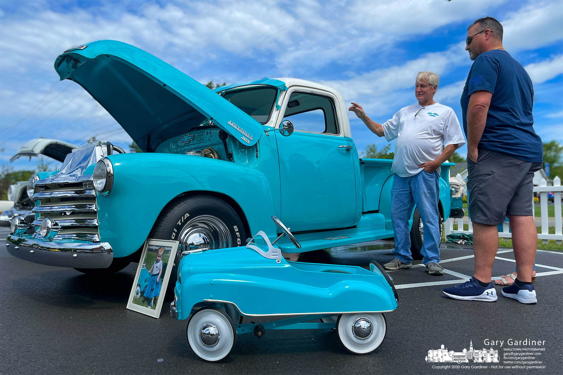 A miniature child's toy version of a 1953 Chevrolet 3100 step-side pickup truck sits beside a restored original truck at Grace Chapel Community Church. My Final Photo for June 19, 2021.