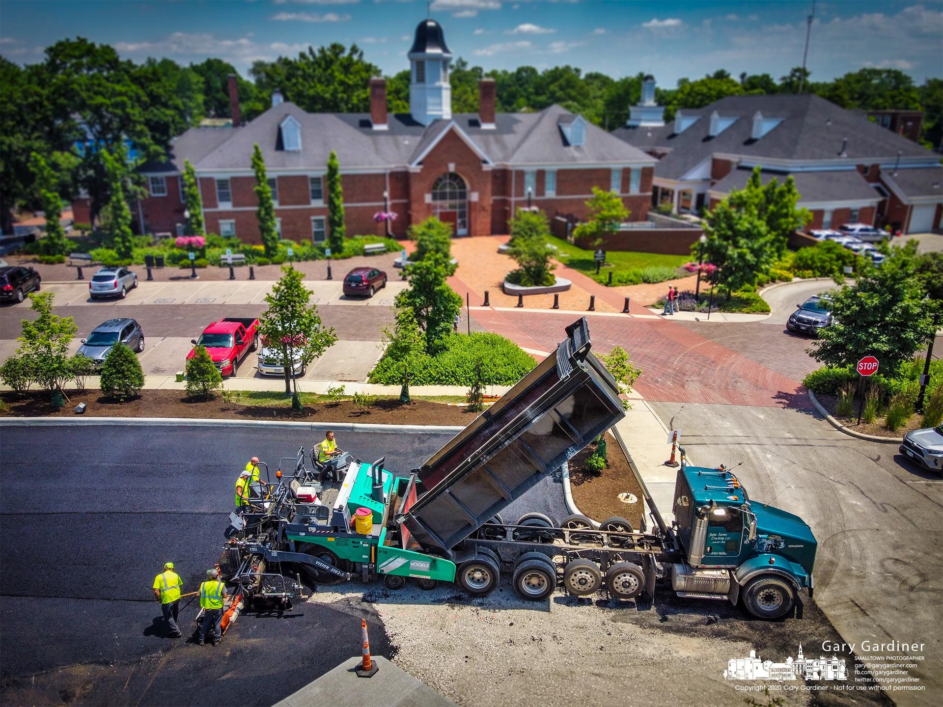 Contractors finish laying the first level of what will be six inches of asphalt to the new parking lot behind city hall. My Final Photo for June 14, 2021.