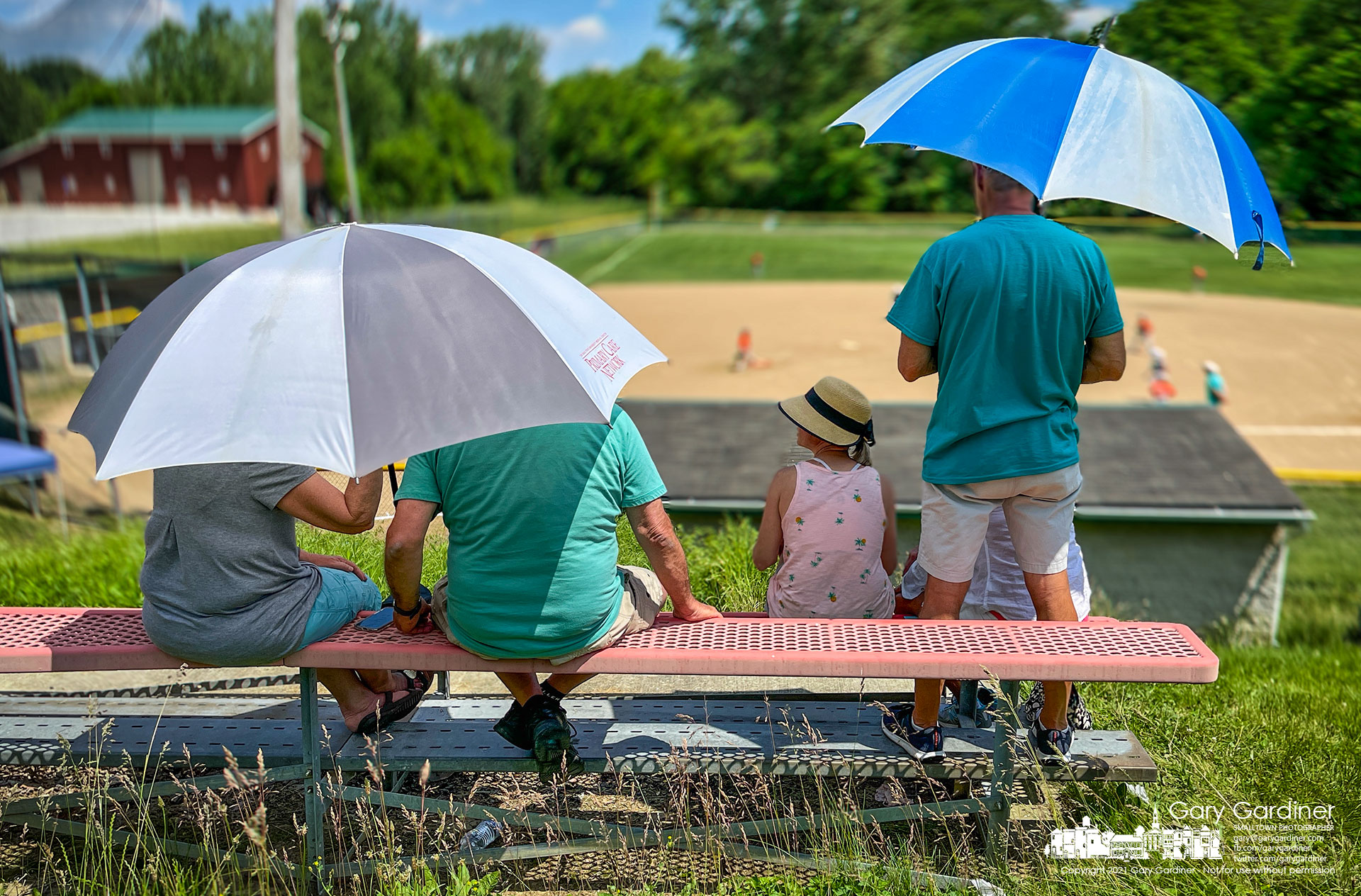 Baseball parents watch their team's game from seats at the upper level of the ballfield in the bottomland along Big Walnut Creek in Galena, Ohio. My Final Photo for June 5, 2021.