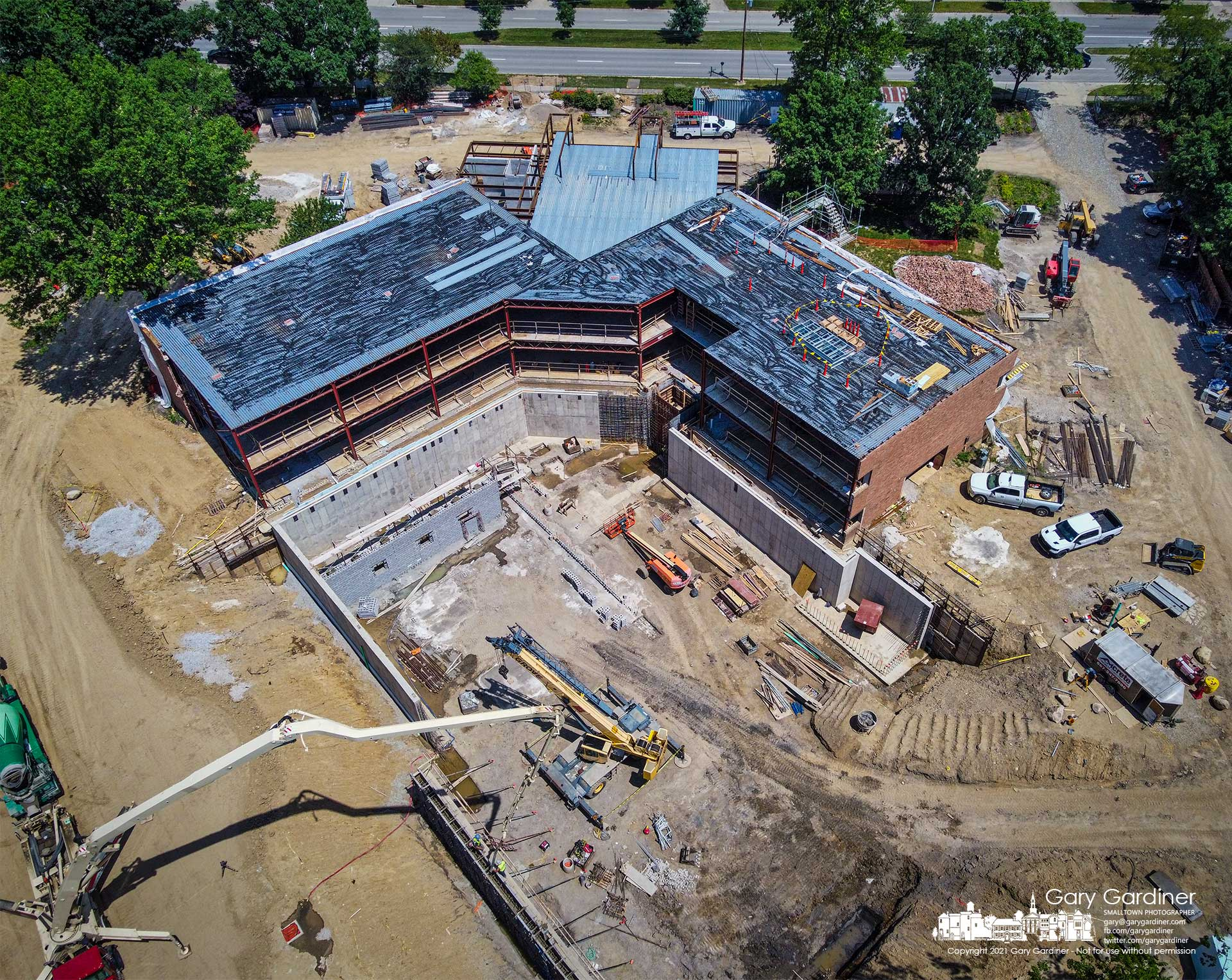 Workers pump concrete into forms that will become the exterior walls of the basement area of the new Westerville Police and Mayors Court which will include a firing range and secure area for the transfer of prisoners into the court system. My Final Photo for June 23, 2021.
