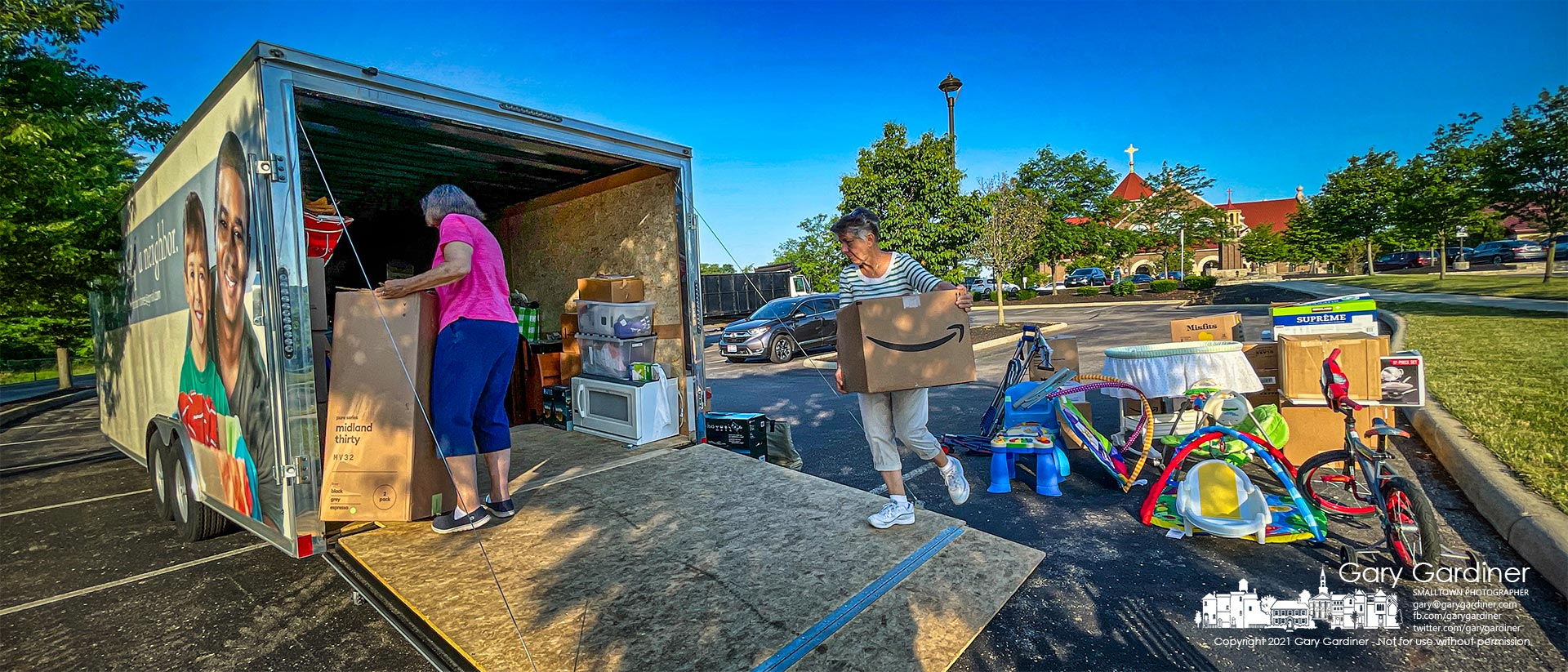 Volunteers sort through the collection of clothing, toys, and household items donated to the St. Vincent DePaul Society during services Sunday at St. Paul the Apostle Catholic Church. My Final Photo for June 27, 2021.
