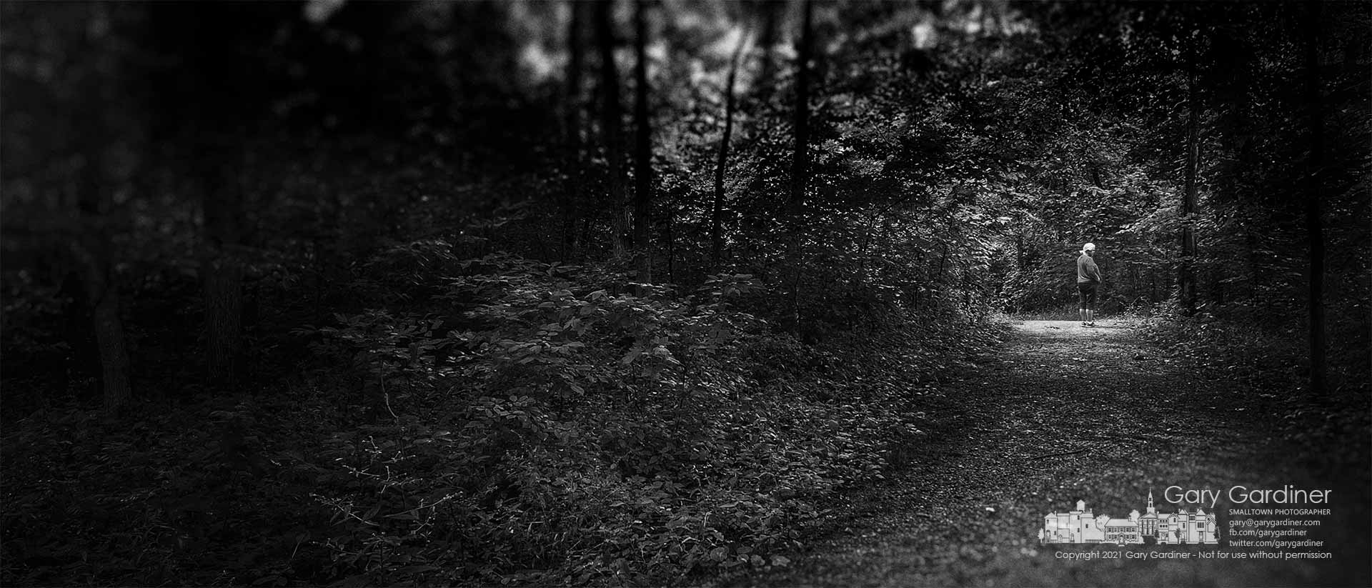 A woman pauses during a walk at Boyer Nature Preserve to wait for her companion to join her along the entrance path. My Final Photo for July 13, 2021.